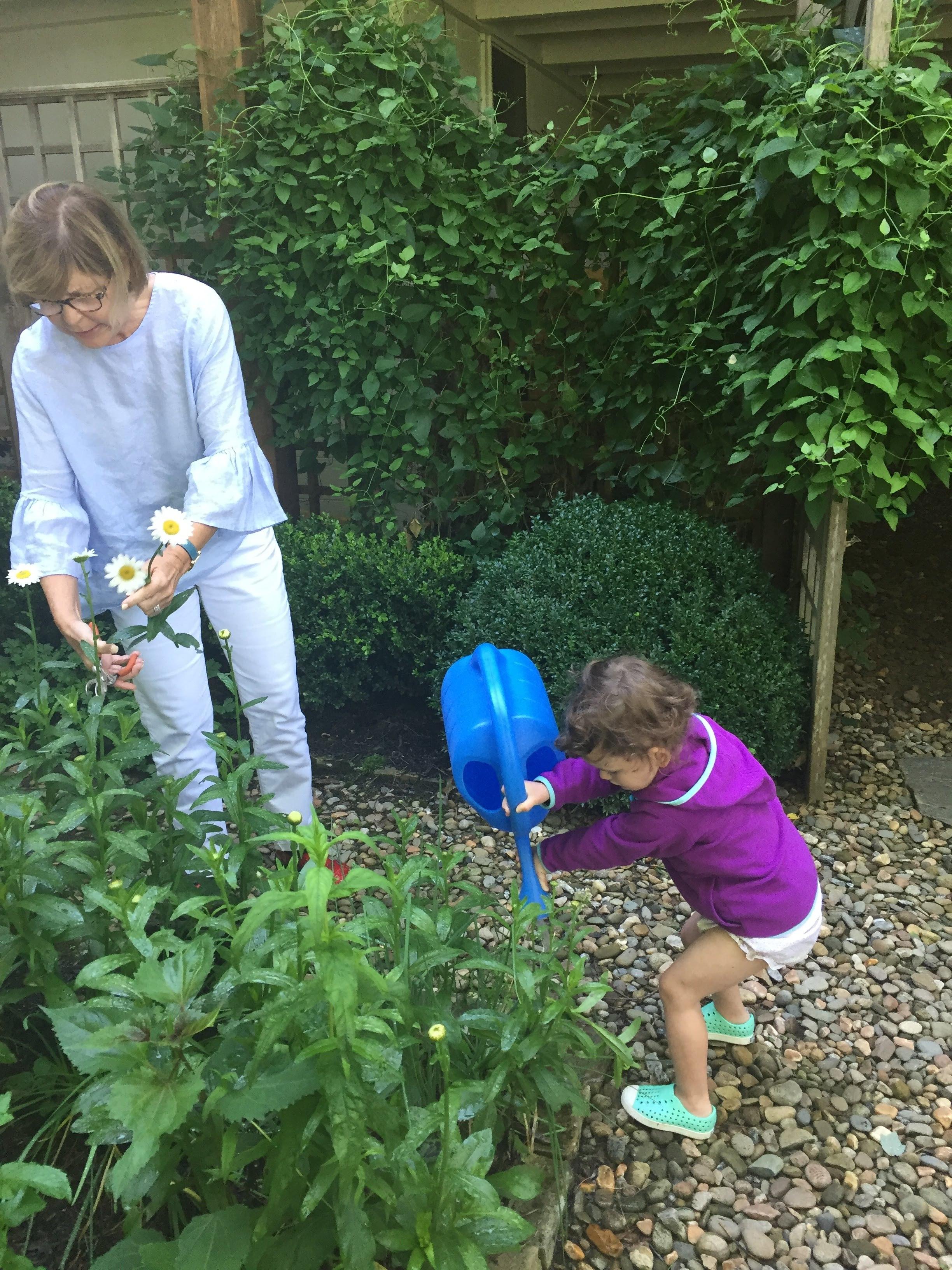 Helping Mimi water the garden