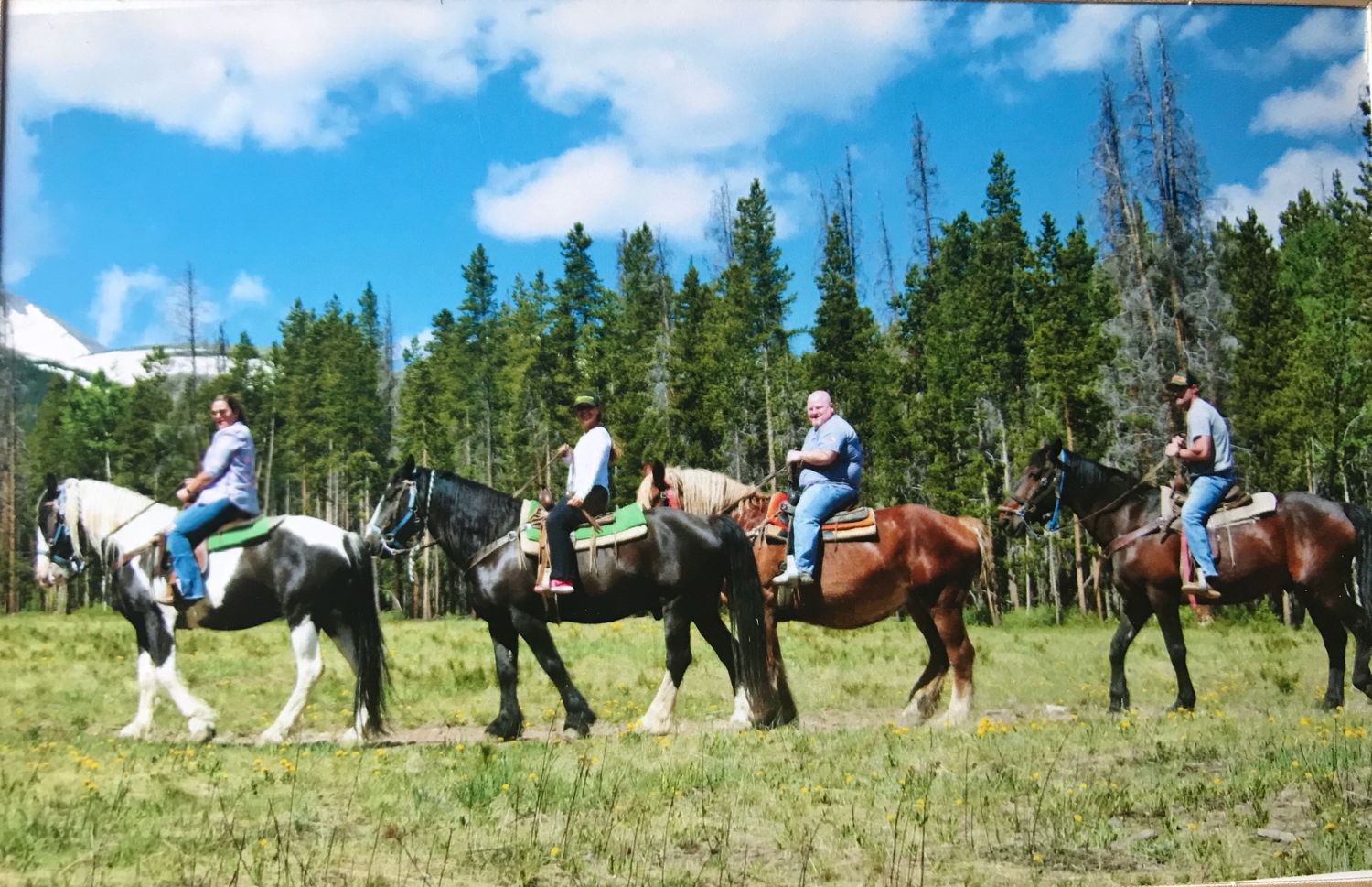 Horseback riding in the Colorado mountains with friends.