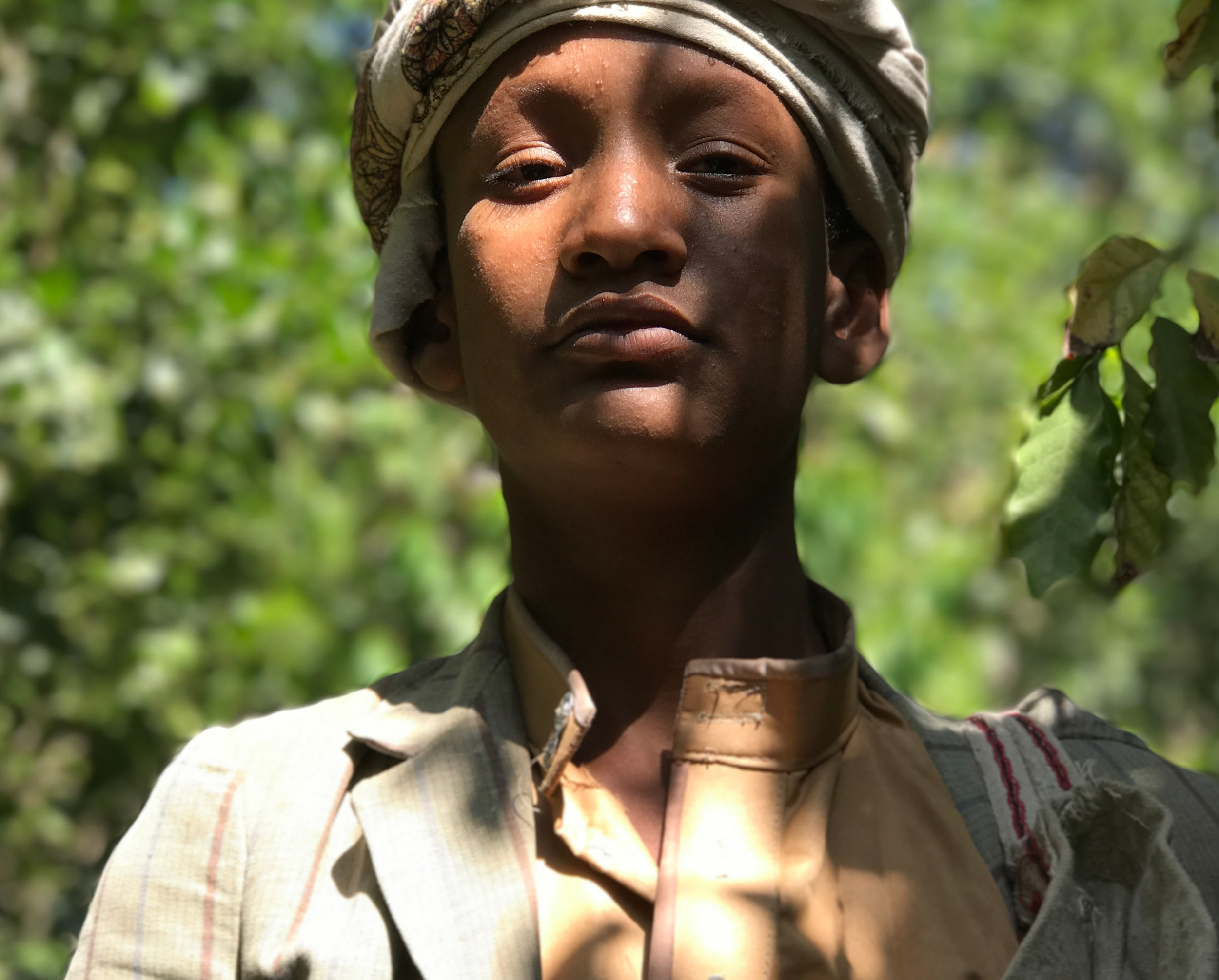 Khaild, a young coffee picker on Hammed's farm.
