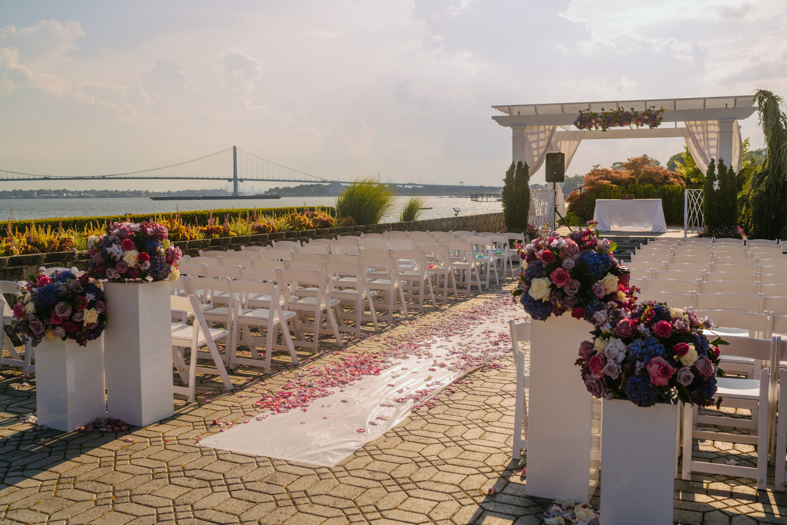 Summer Wedding Ceremony of Purple and Pink flowers. The perfect view