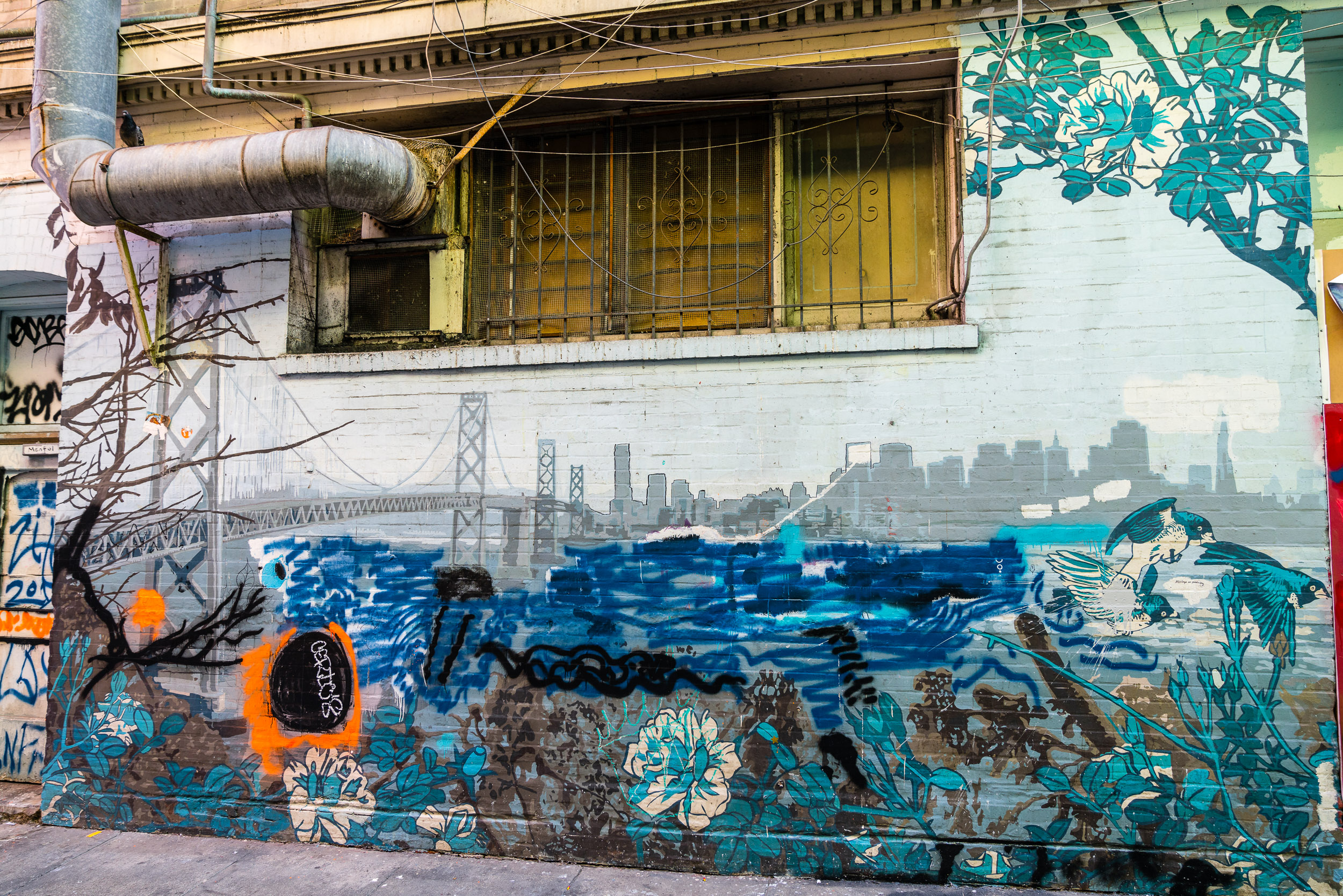 Sad to see this mural getting peppered over by other graffitis. I would've loved to see it in its original form.