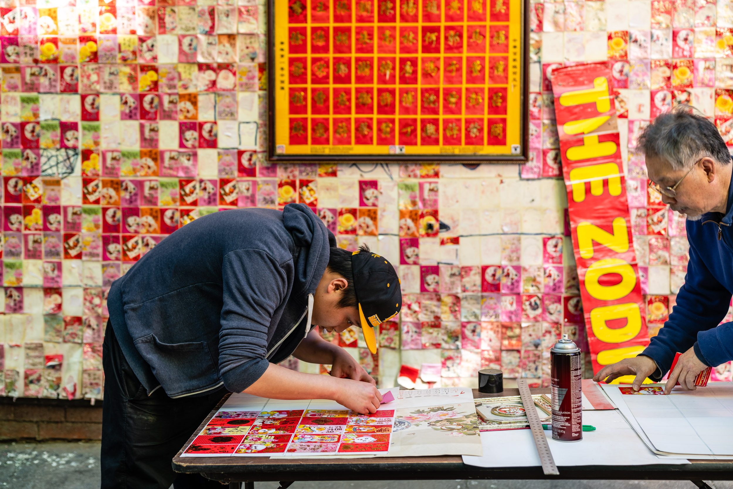 During our escapades we ran into these two artists doing repair work to this art installation consisting entirely of Chinese red envelopes.