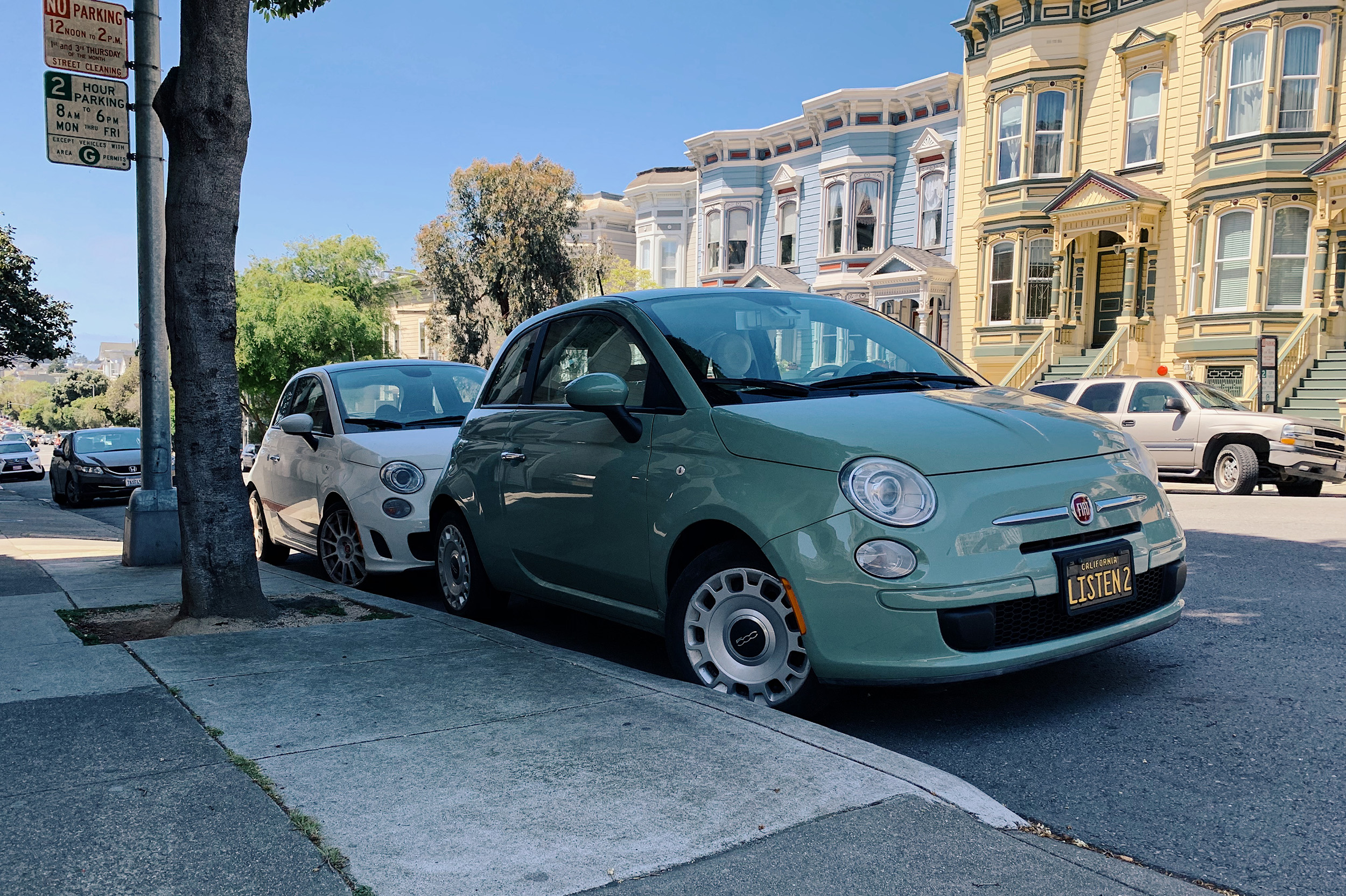 This is brilliant: two Fiat 500s fitting in one San Francisco street parking spot.