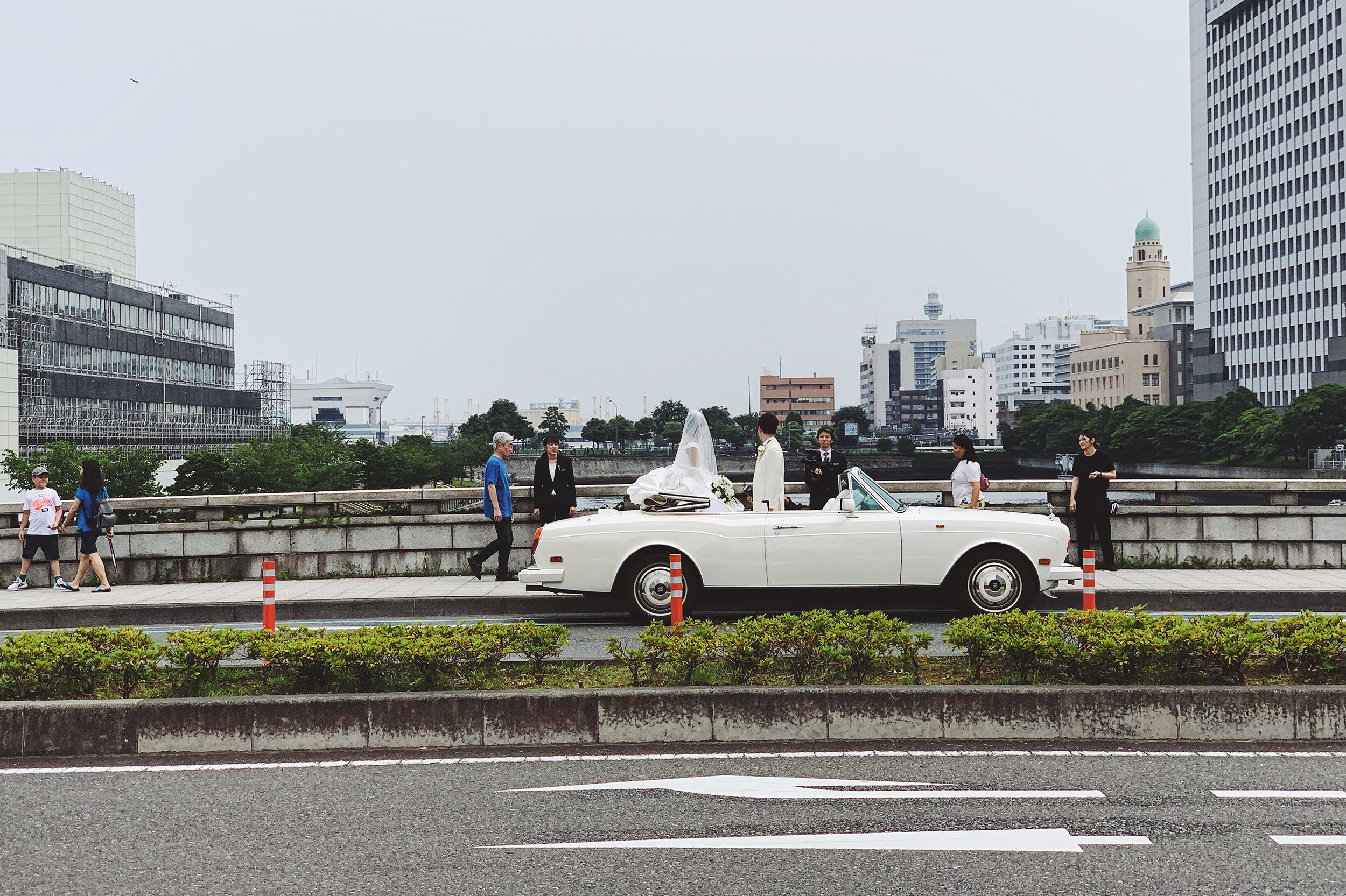 Spare a thought for the groom-to-be decked out in full tuxedo in Japan's hot and humid summer weather.