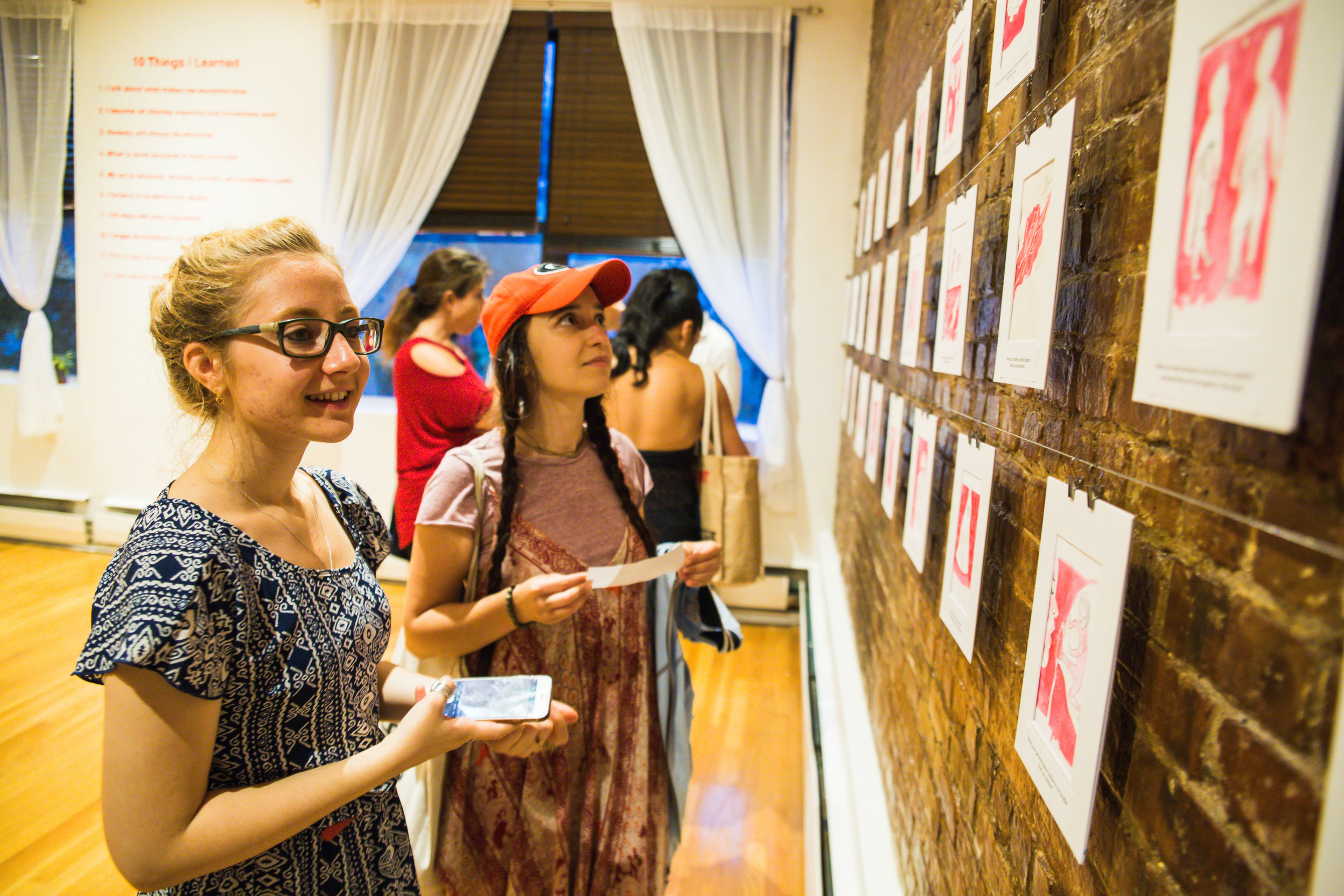 Guests viewing the art and reading each caption.