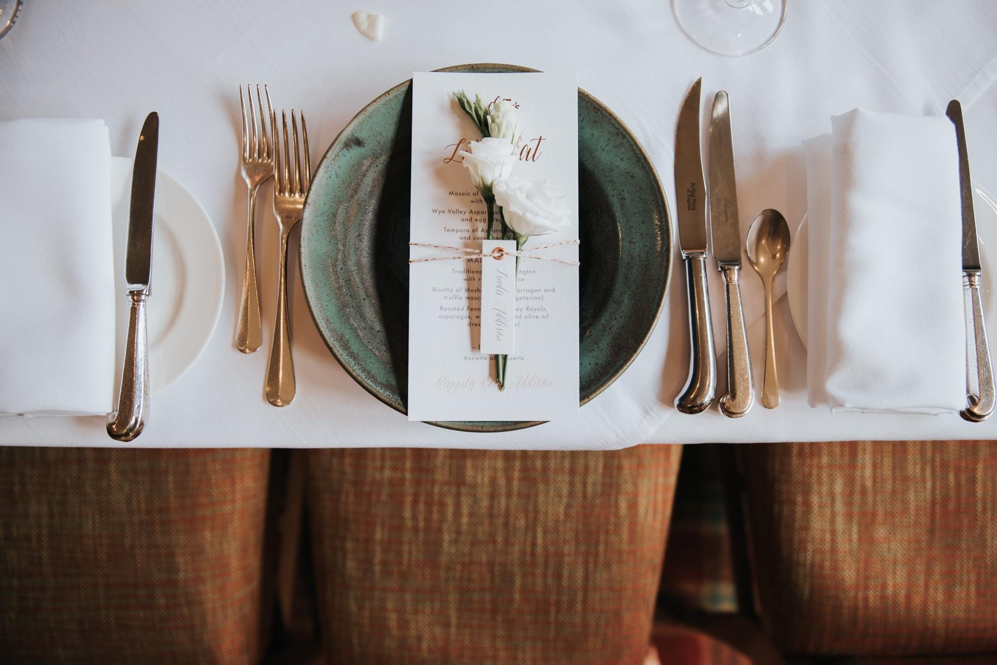 Wedding table setting with venue and place names
