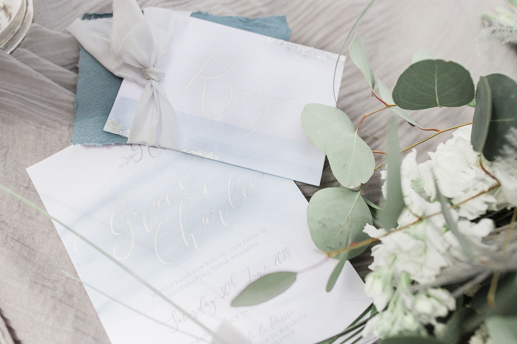 Blue watercolour wedding invites with silver hot foil lettering