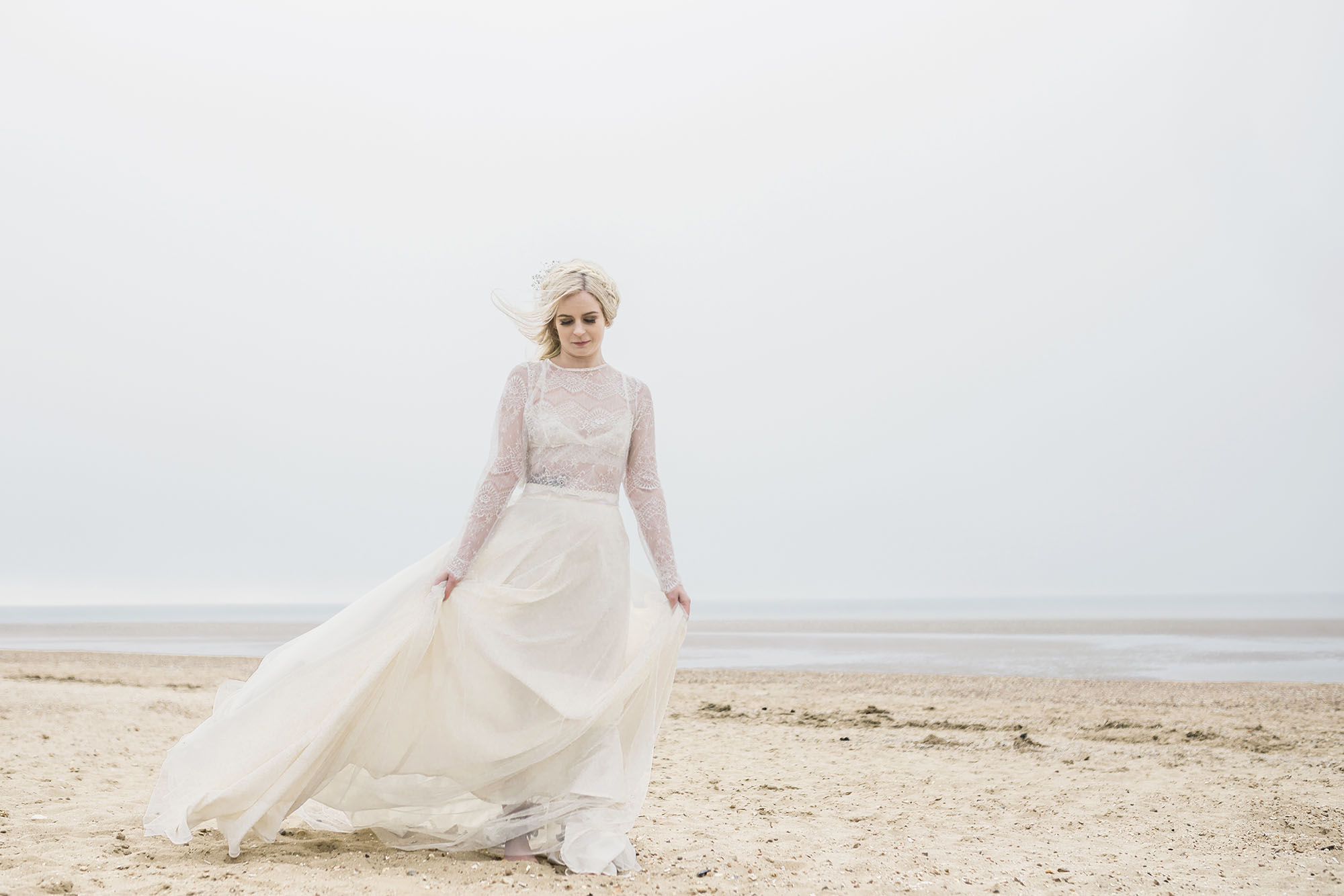 Ethereal bride walking on a beach