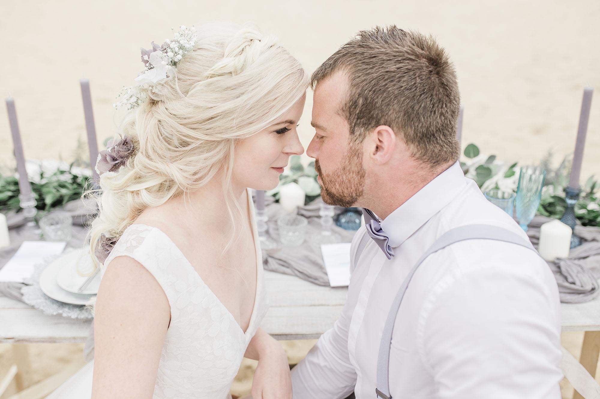 Bride and groom on an ethereal beach wedding shoot