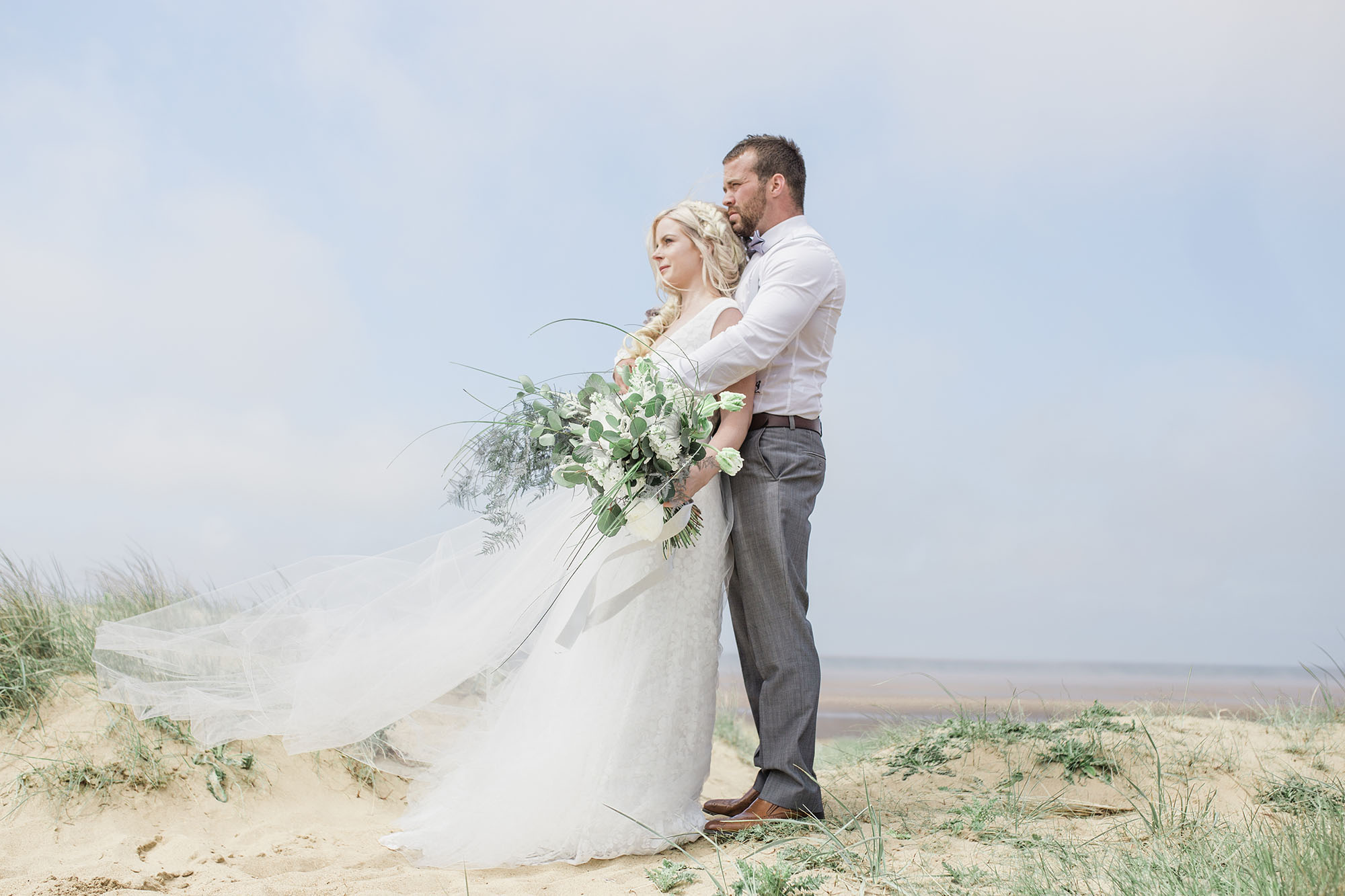 Bride and groom on an ethereal beach styled shoot