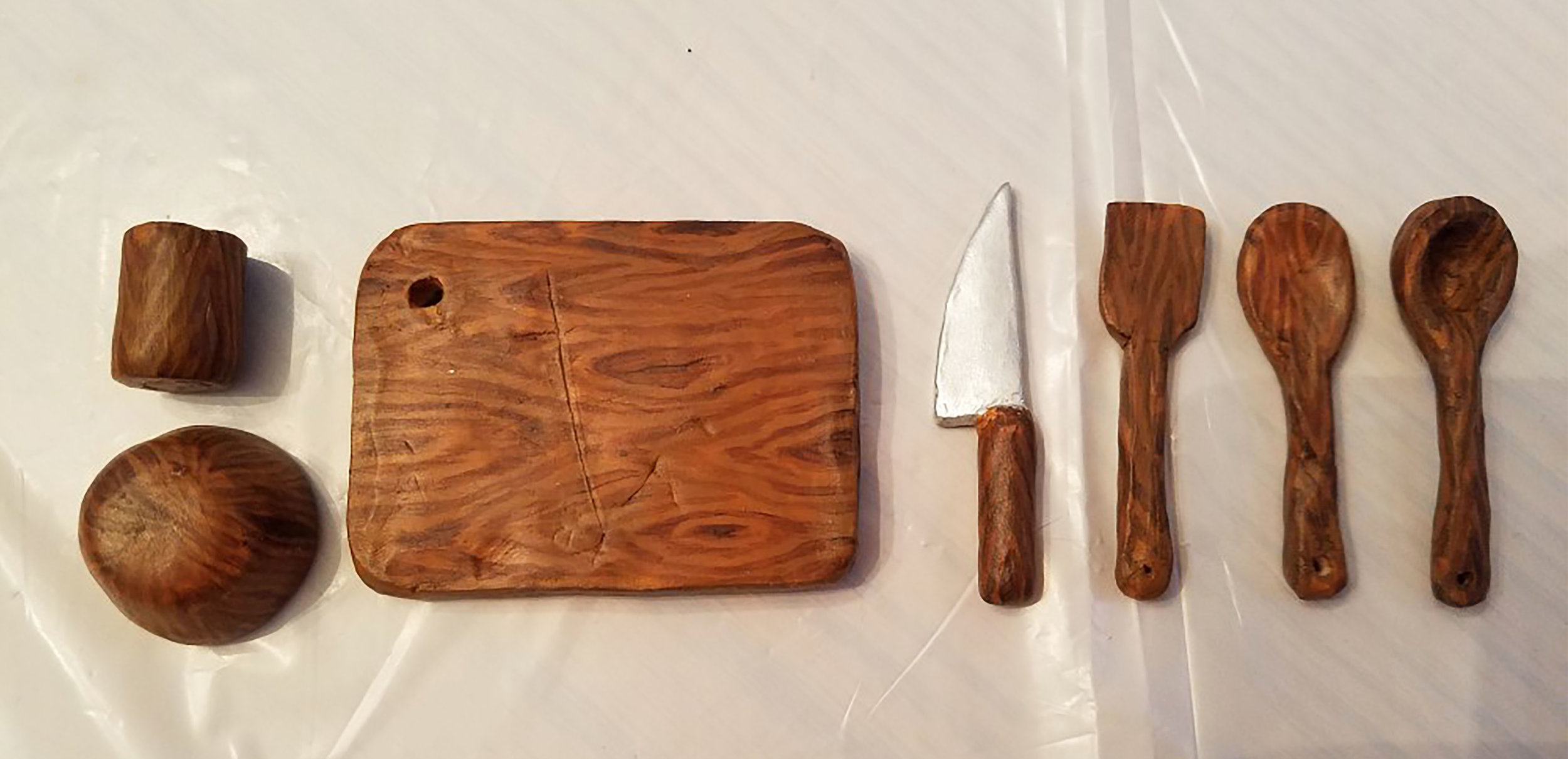 wooden cutting board and utensils.jpg