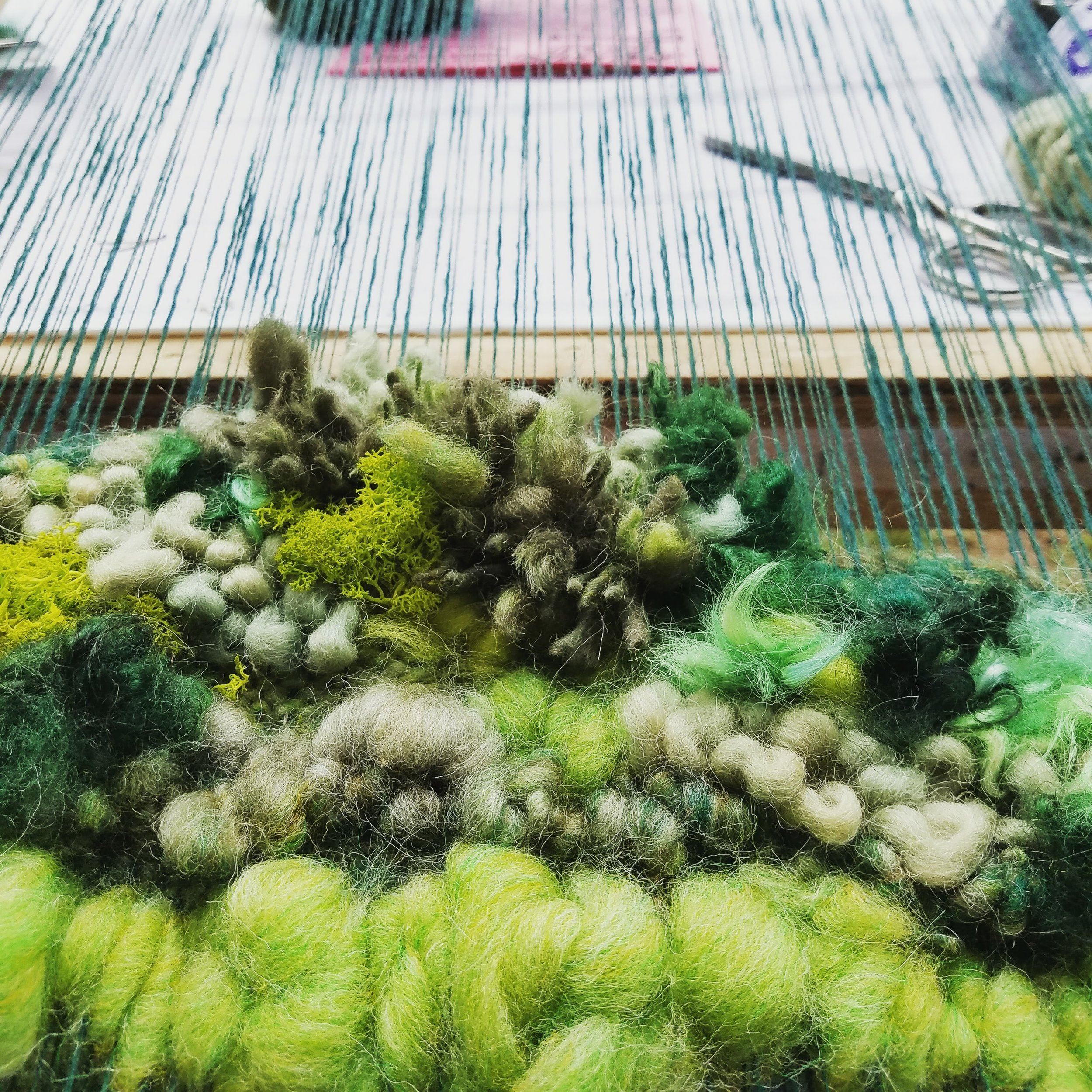 Forest Floor Weavings - Each forest floor weaving is made with a variety of materials, yarns, roving, dyed silks and wool locks as well as preserved reindeer moss. Every weaving is unique in its design and every weaving is reminiscent of mossy forest floors. Choose a custom size weaving for your home and bring the forest inside.