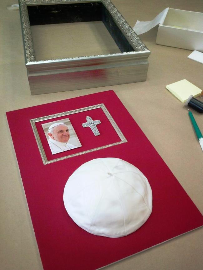 The elements are ready for assembly: frame, mat, and mounted objects.