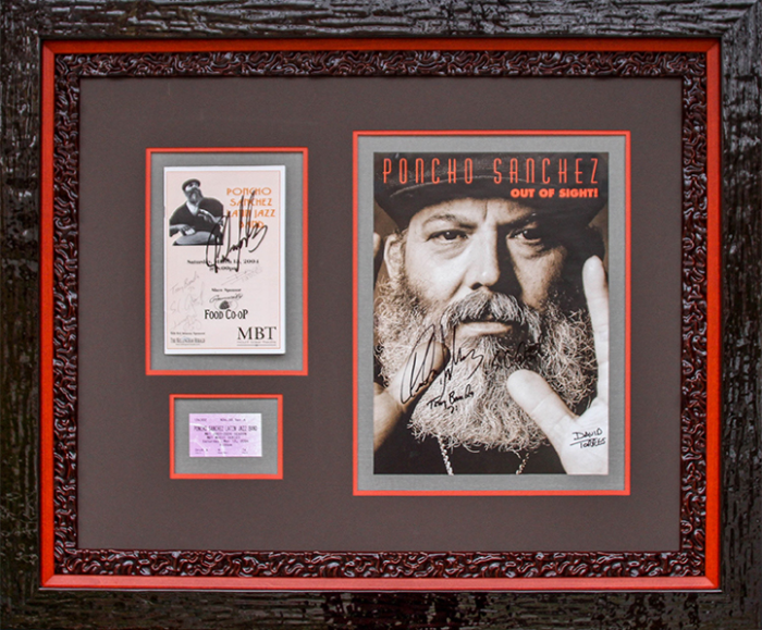 Music Memorabilia in Jazzy Lacquer Frame - A special concert ticket, program, and autographed card are set into a rich brown mat with red accents to add a jazzy touch. The design is completed with a stacked black lacquer frame and Museum Glass for maximum viewing enjoyment and protection.