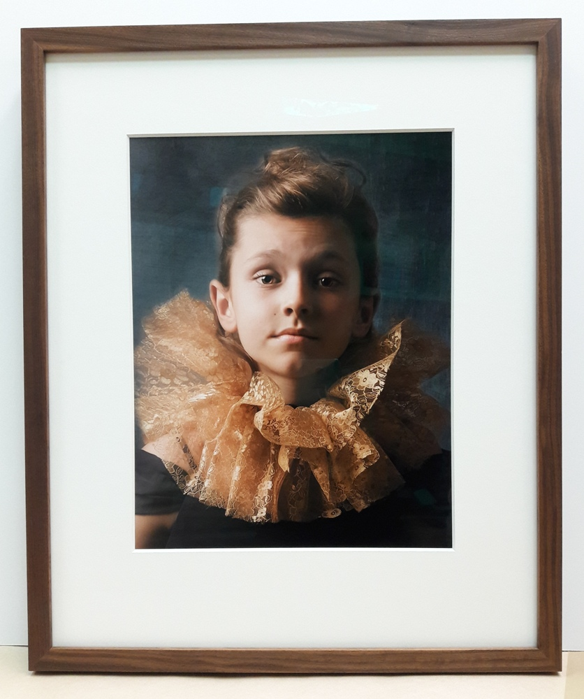 Portrait of a Girl in Walnut Frame with Museum Glass and Wide Matting - This fantastic portrait is given gallery treatment with a wide white mat and walnut frame to pick up the warm tones. Museum Glass completes the project to protect it from UV light damage and minimize reflections.