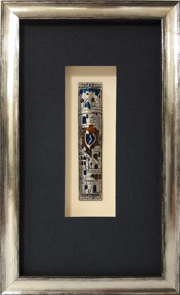 Mezuzah in Silver Gilded Frame and Deep Blue Linen Mat Makes a Perfect Gift - This charming gift was created by mounting the mezuzah on a cream mat inside a raised window. A deep frame was chosed to accomodate the object and make a dramatic depth. Silver tones and the deep blue create a sophisticated aesthetic.