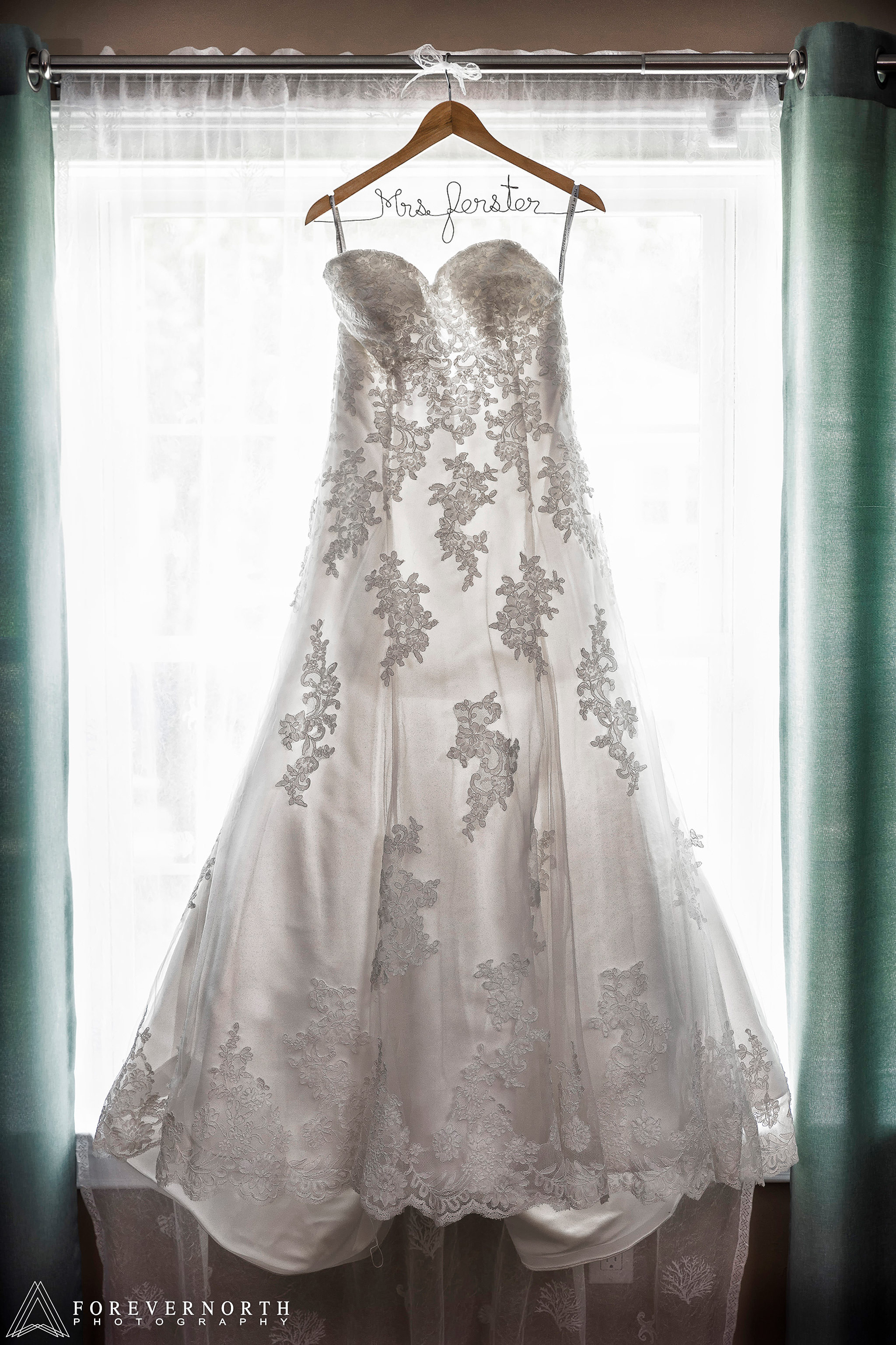 A detailed shot by the wedding photographer of the bride's dress.