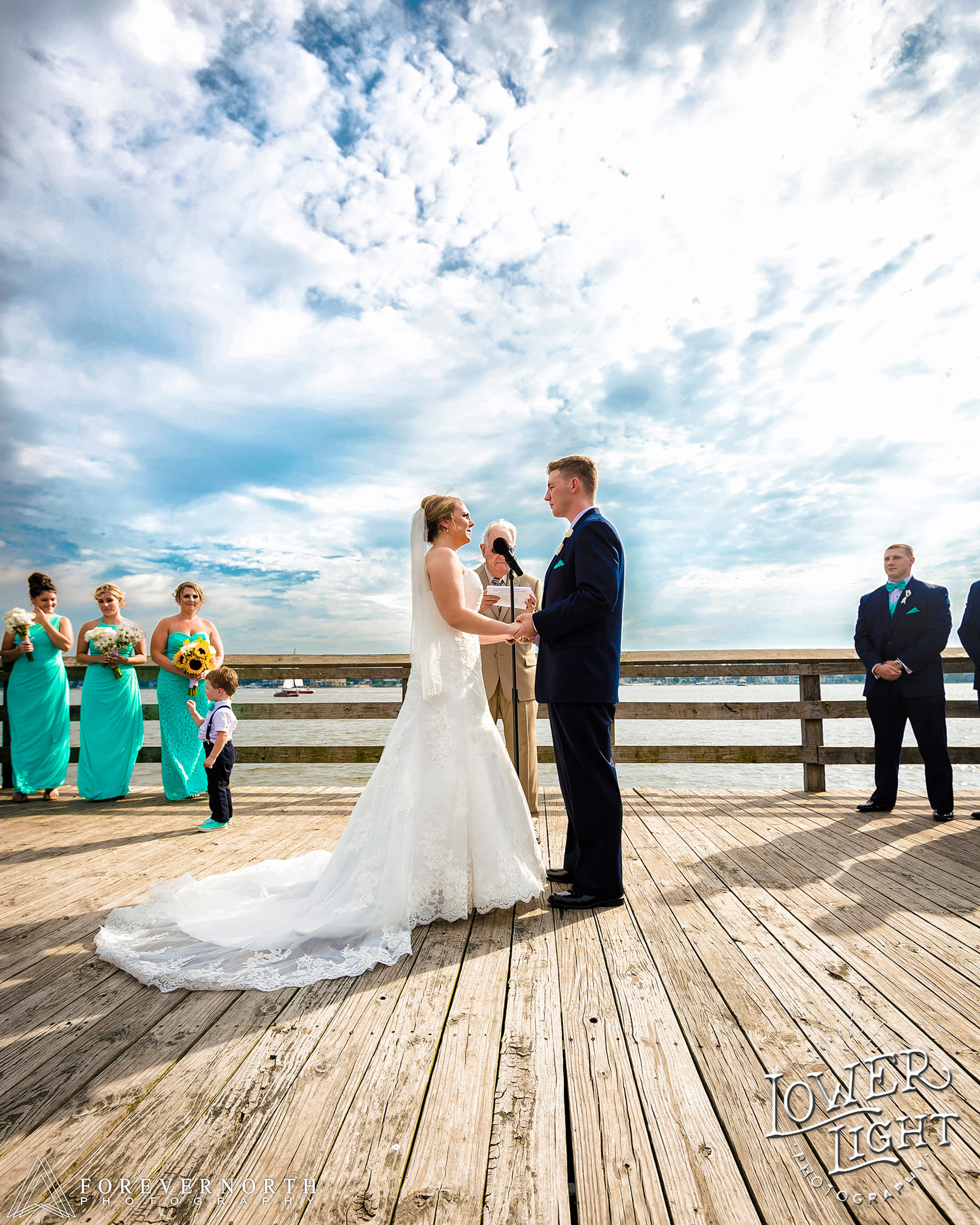 a beautiful sunny day at windward beach during the ceremony of the wedding