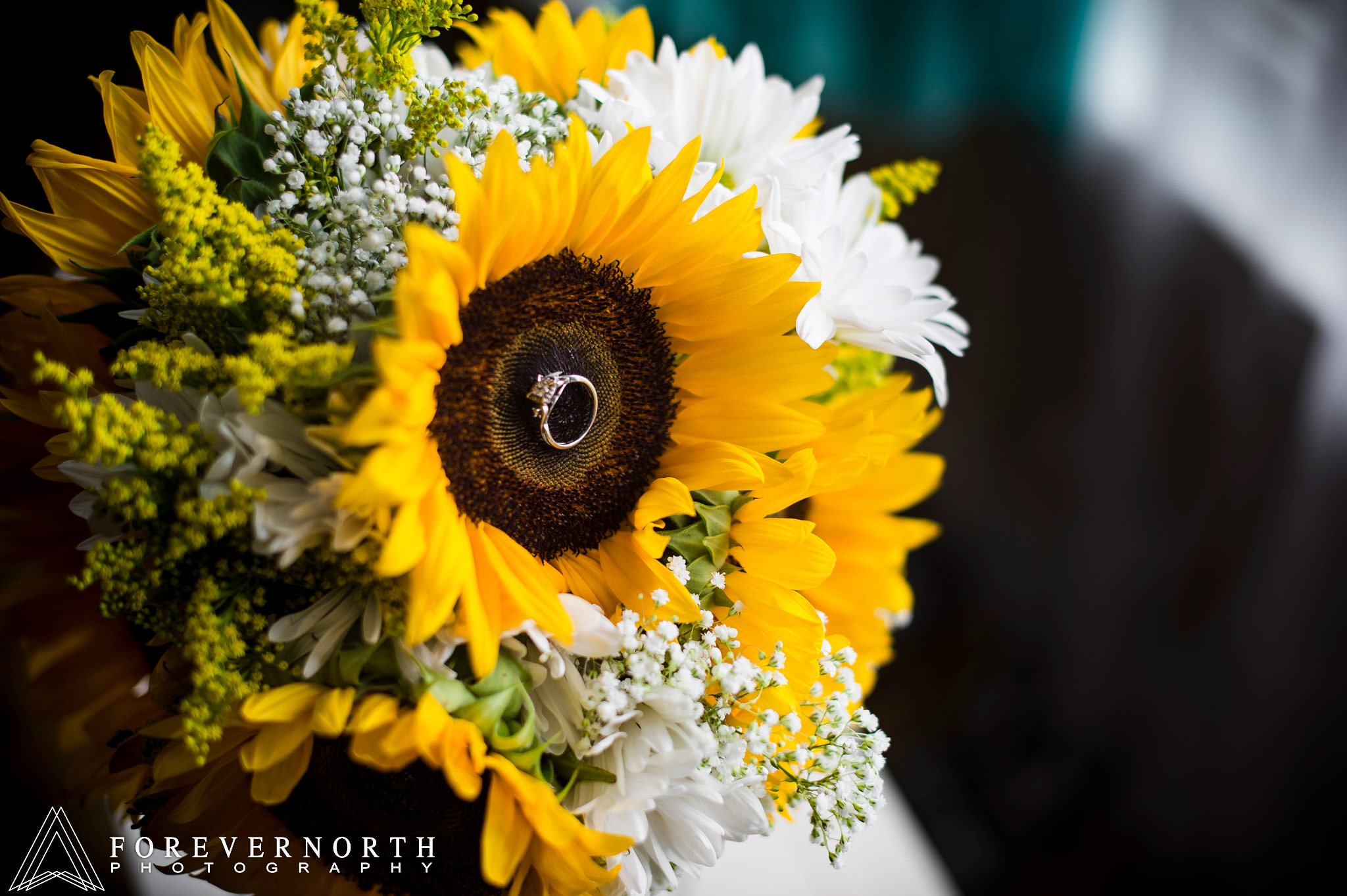 Wedding ring inside sunflower. The sunflowers are the wedding decoration