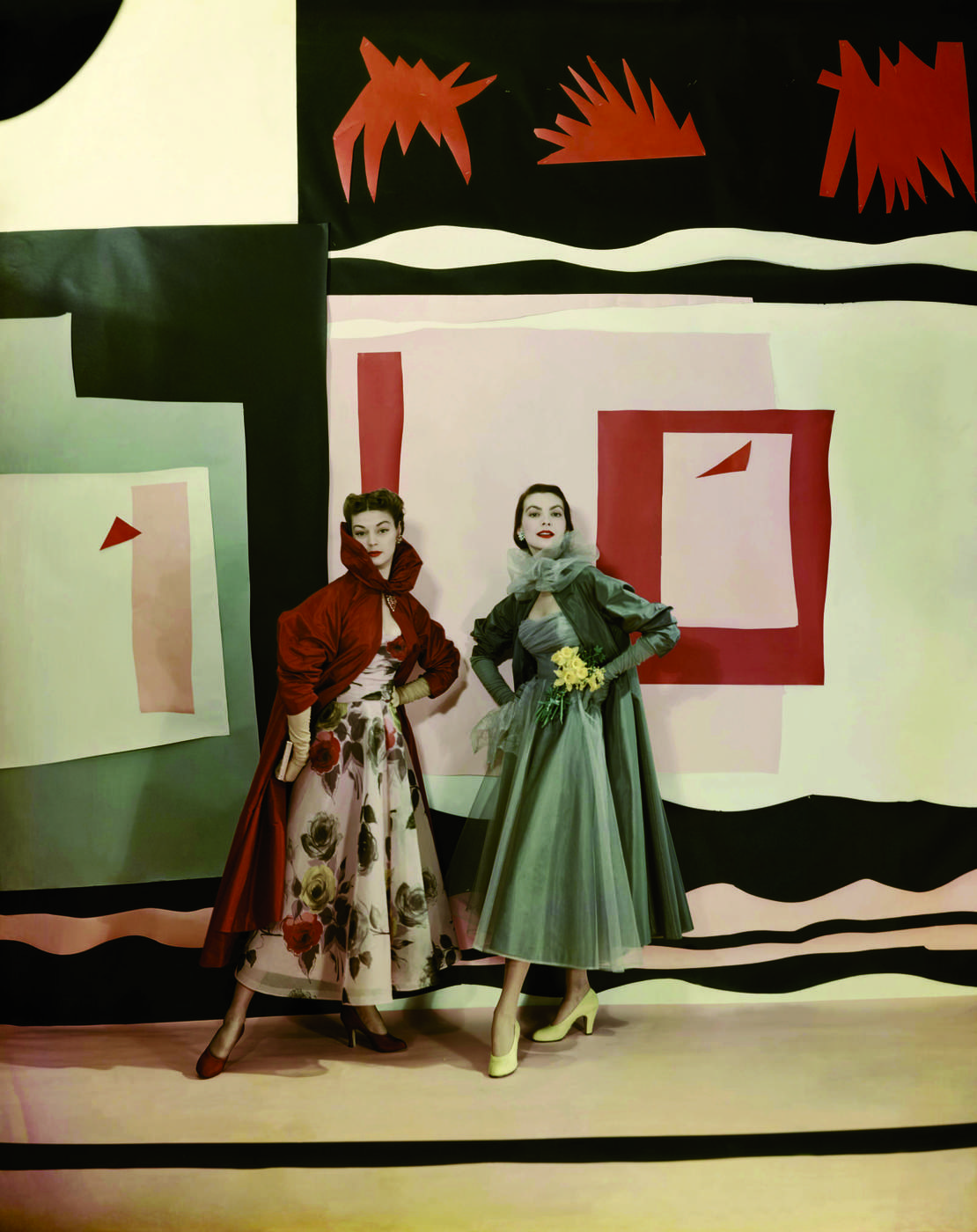 Jean Patchett and Carmen Dell'Orefice model Ceil Chapman eveningwear in front of a back-drop inspired by Matisse's 'Jazz', photographed for Vogue by Cecil Beaton,.jpg