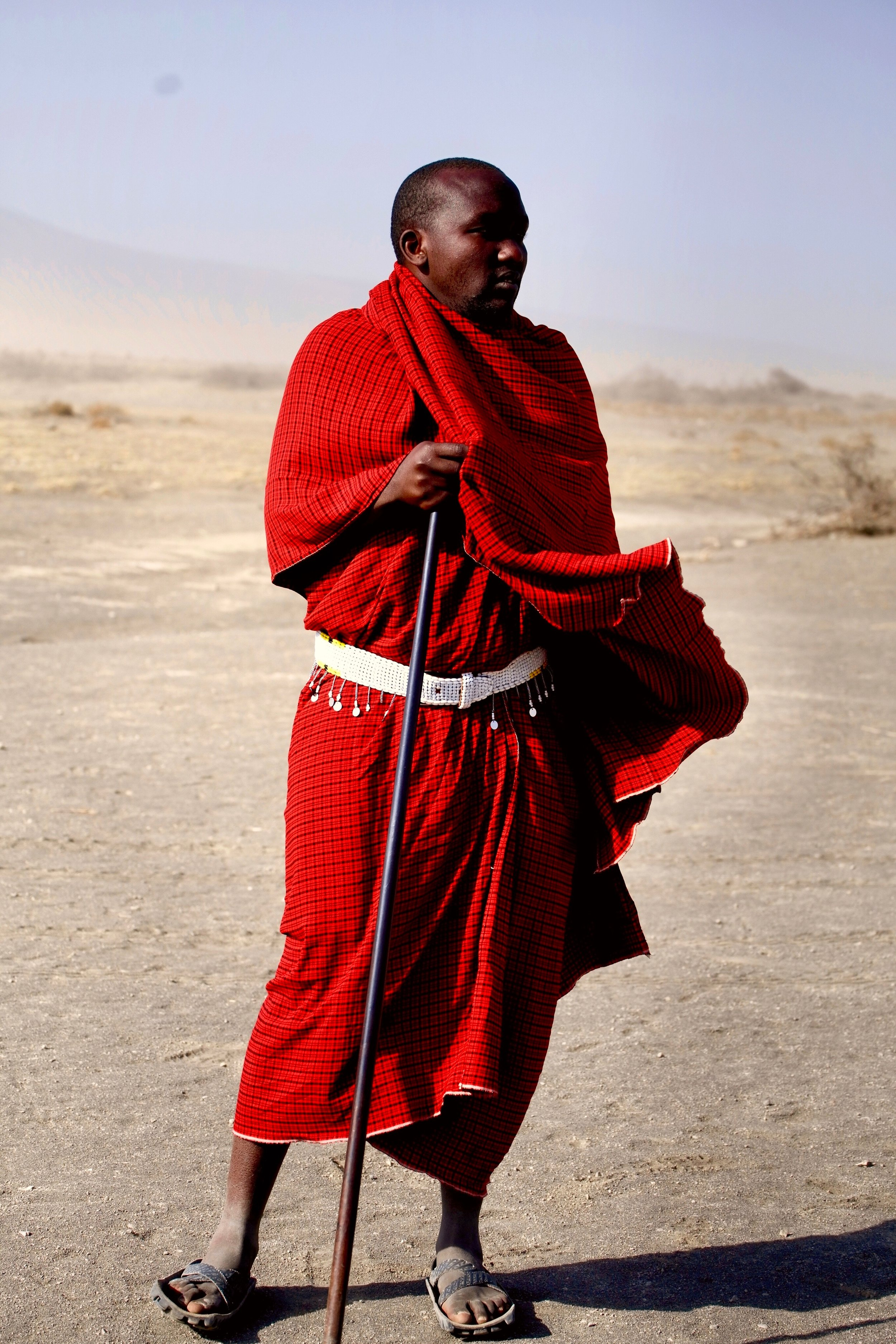 African man wearing red clothing as in robes