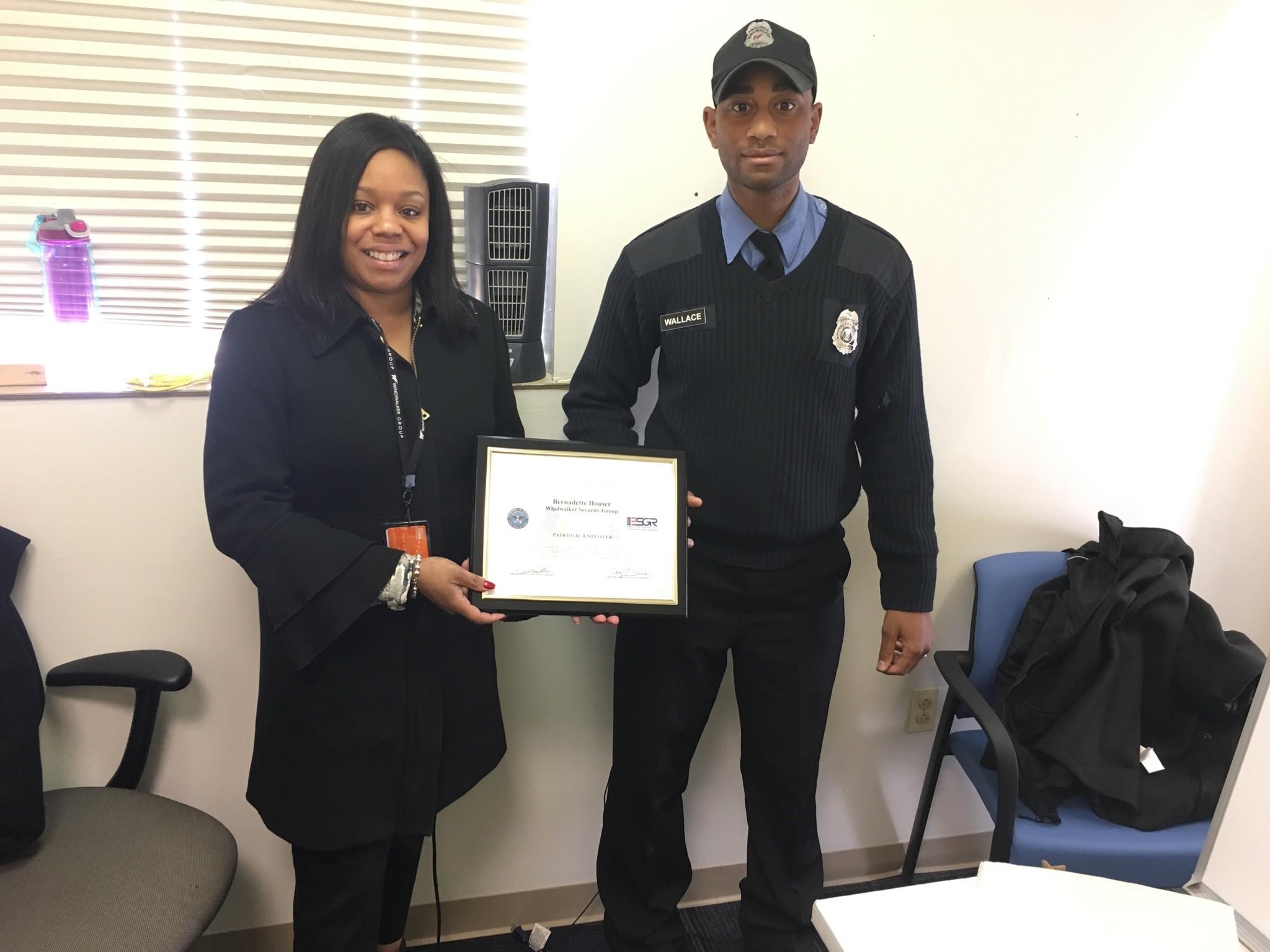 Windwalker employee Bernadette Houser receives a Patriotic Employer Award from the Philadelphia National Guard
