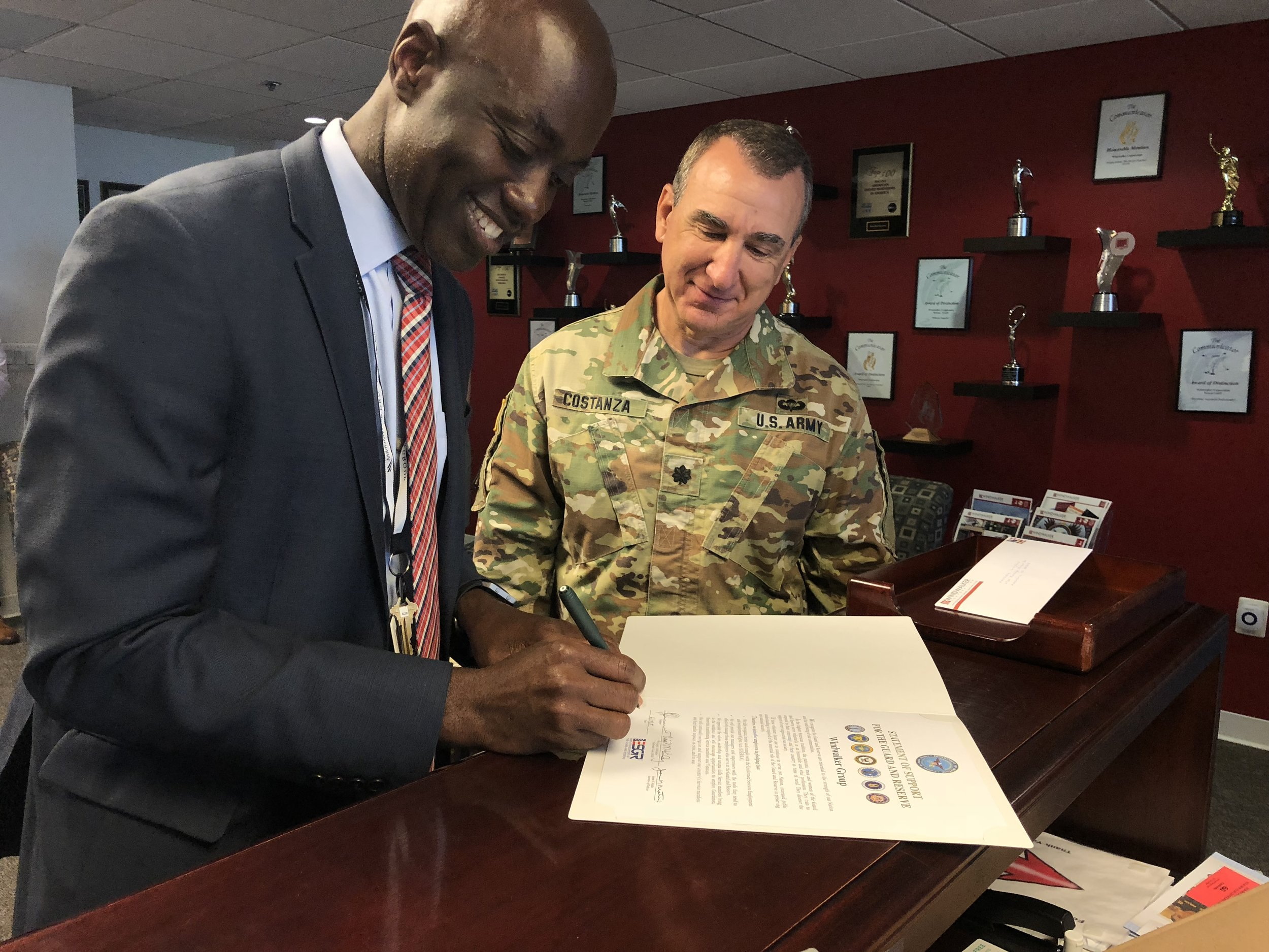 Windwalker's CEO Herby Duverné receives the Department of Defense Patriot Award, recognizing Windwalker Group's policies and practices that facilitate employee participation in the Guard and Reserve. This award honors Mr. Duverné for his superior support of Guard and Reserve employees.