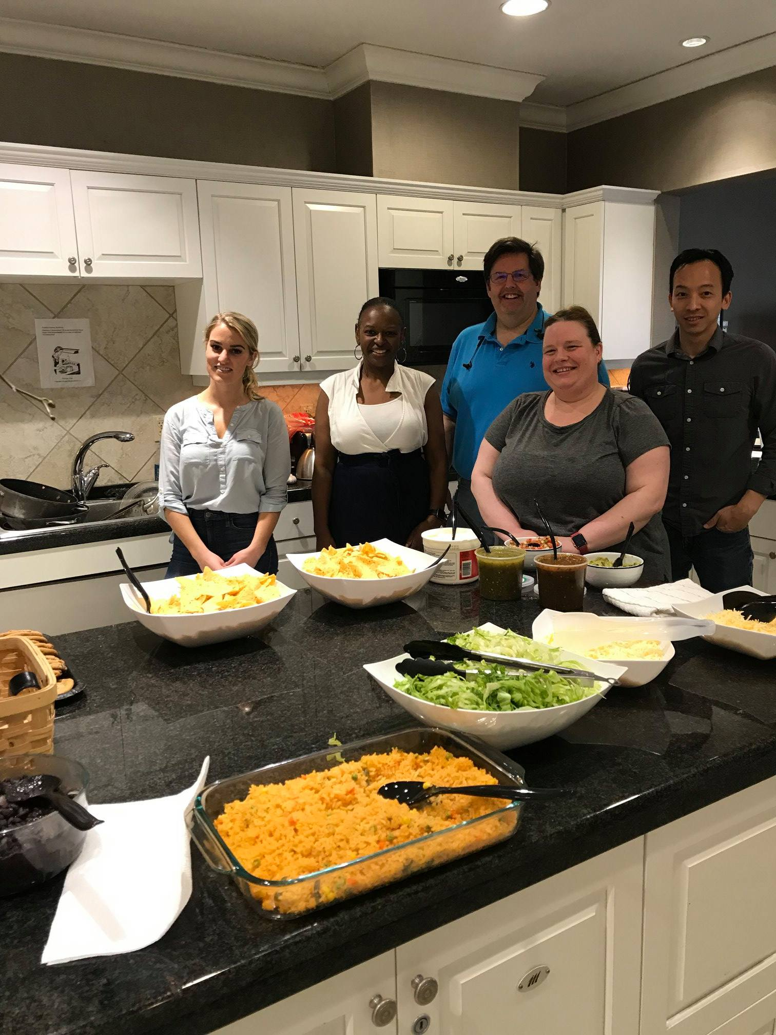 Windwalker team members volunteering at the Fisher House in Washington, DC by preparing dinner for its residents