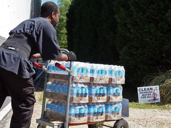 Neighbors unloading water