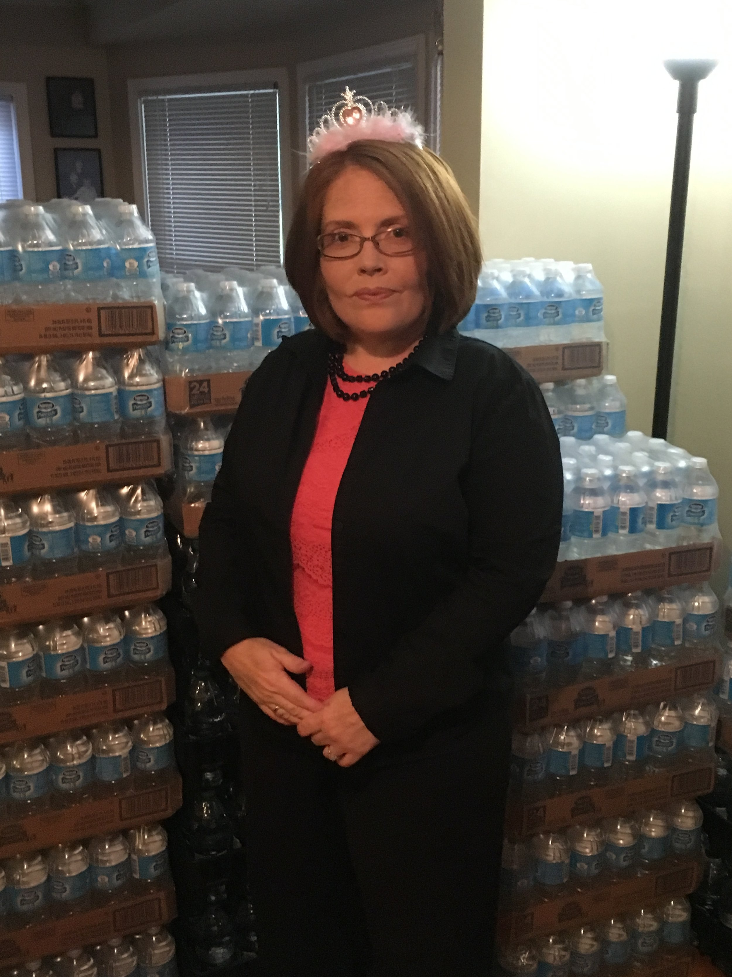 Amy Brown standing in front of water inside her home