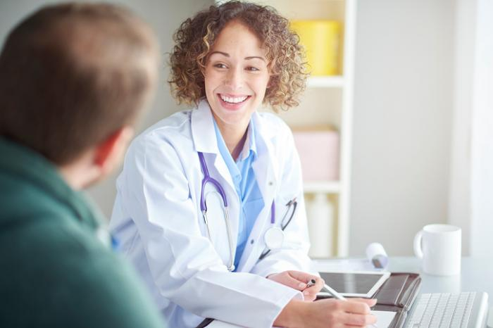 female-doctor-laughing-with-patient.jpg