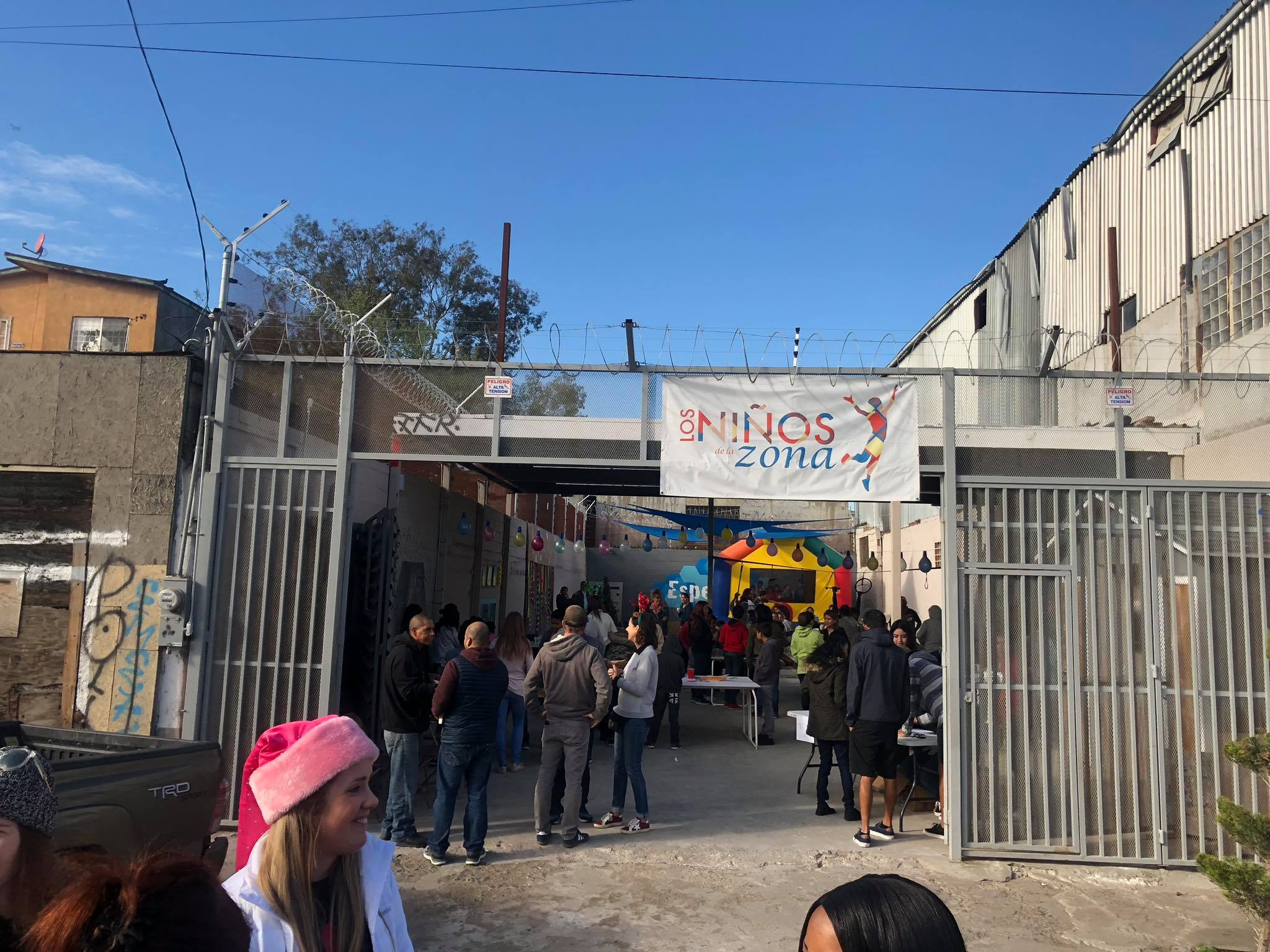 The entrance to Hope Zone- an outdoor space between two buildings, lined with barbed wire.