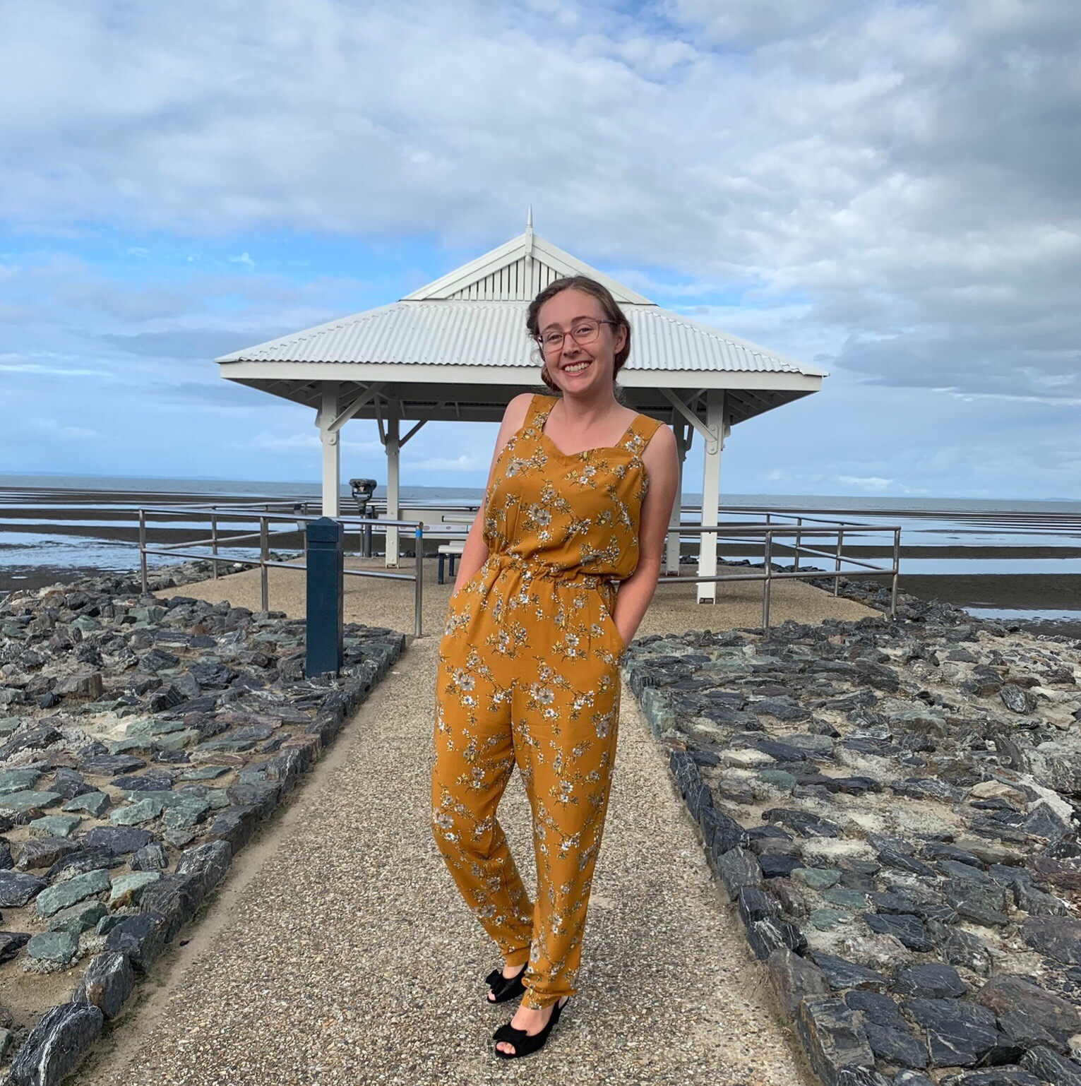 Learn to follow a pattern and make your own clothing. Cait wears a mustard yellow jumpsuit she made herself from following Tilly and the Buttons Marigold Jumpsuit pattern.