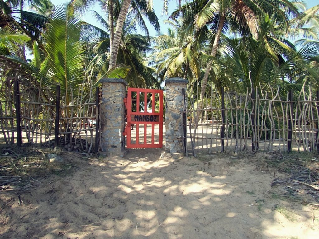 This little red gate is the only thing between you and the beach
