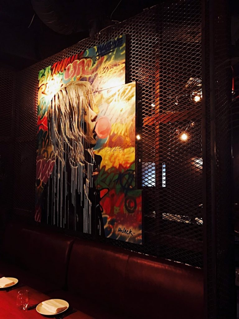 You'll see artist HiJack's work around the restaurant