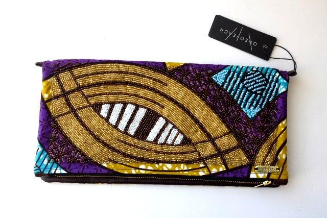Beaded Ivory Coast print with brown ox hide   South African handbag designer  ONEOFEACH produces beautifully bright and unique fold-over clutch bags (which conveniently come with a strap so you can also wear it as a crossbody). The traditional print fabrics are sourced from around the continent and no two bags are the same.   Visit ONEOFEACH