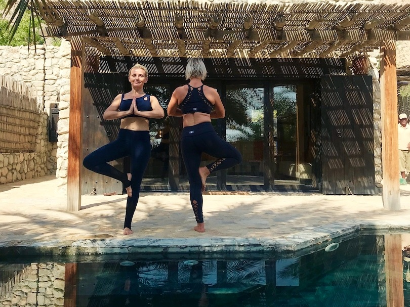 A little pool-side tree pose to find our inner zen (and balance)  Clothing: Yoguh London