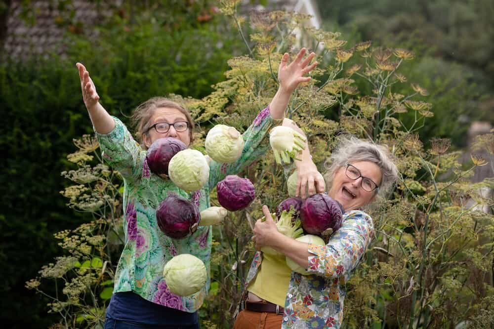 Jo and Katie tossing cabbages in the air again