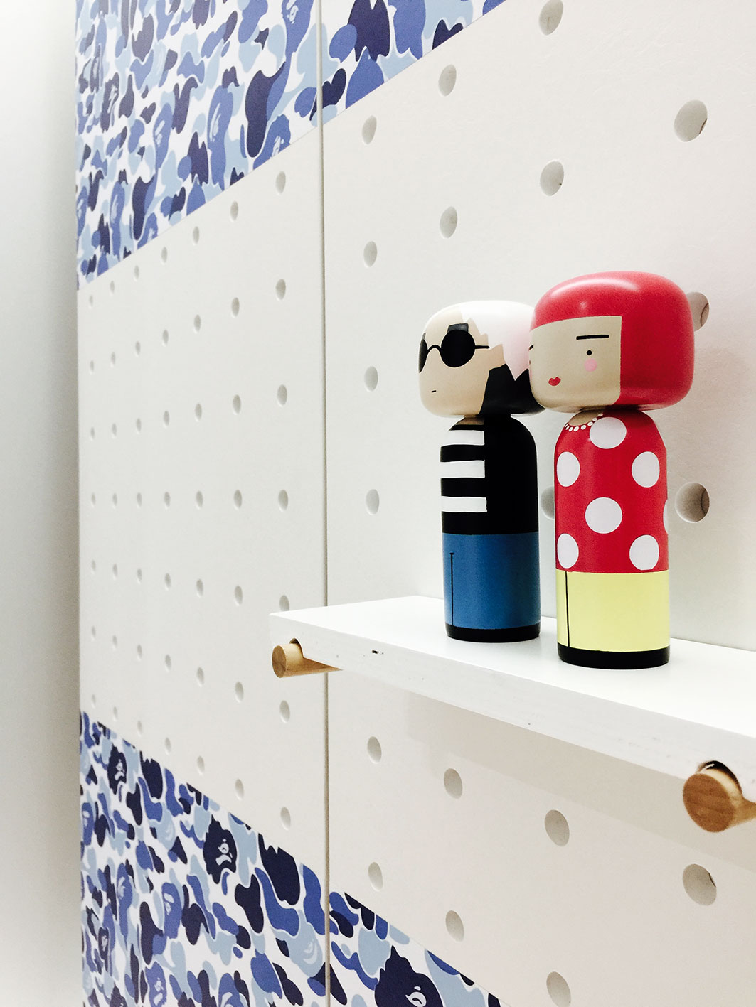 Wardrobe integrated with pegboards.