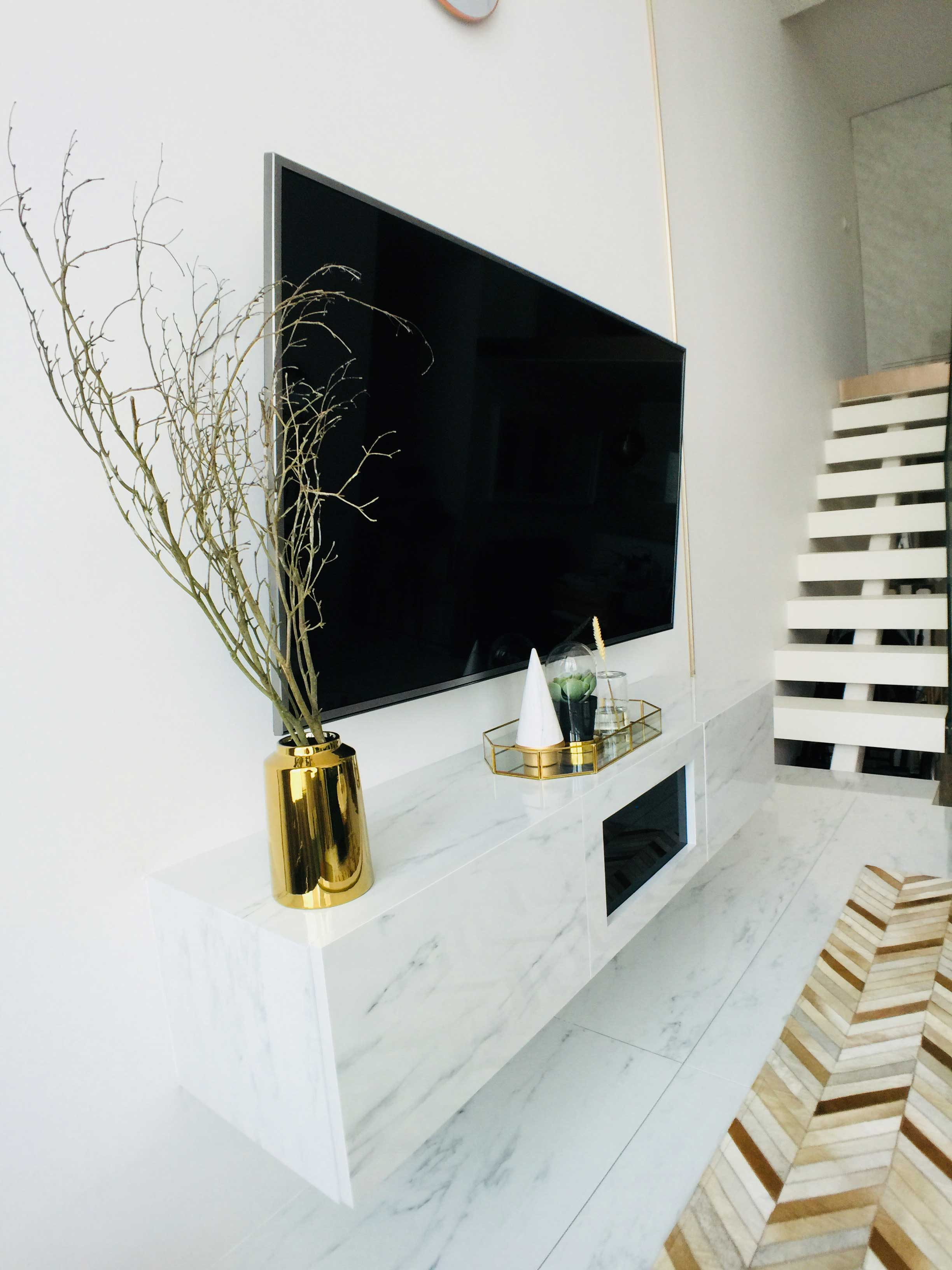 Marble textured laminate complements gold accent perfectly.
