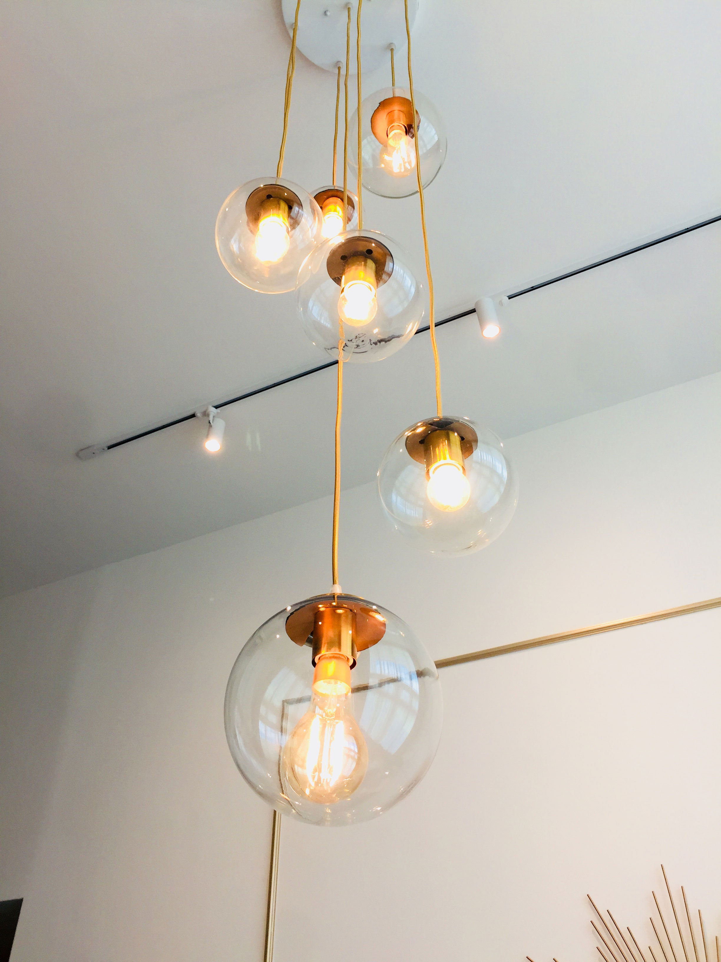 Luxury of height is accentuated with multiple pendant lighting that draws the eye up to appreciate the vast vertical space.