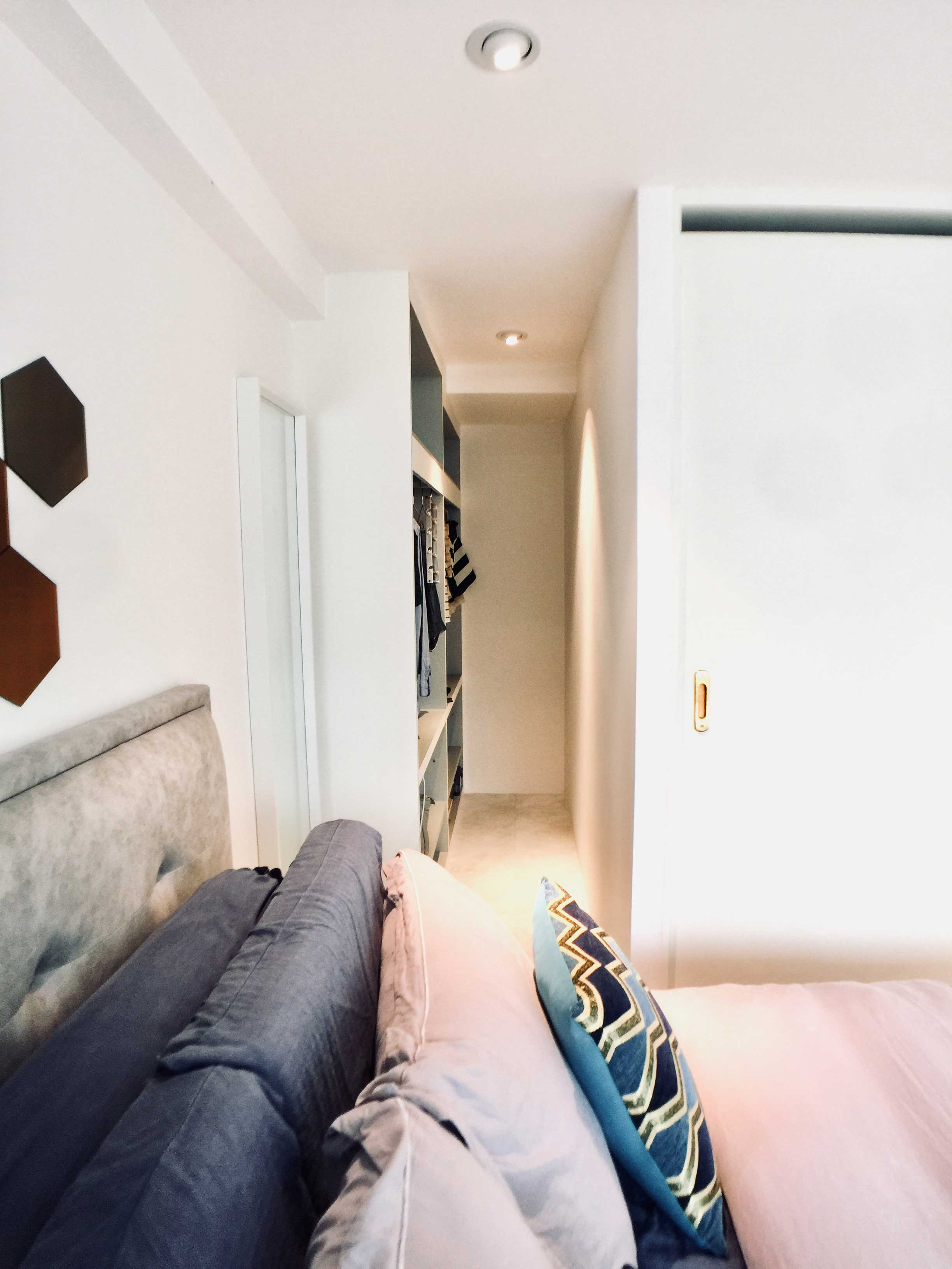 Walk-in wardrobe in master bedroom.