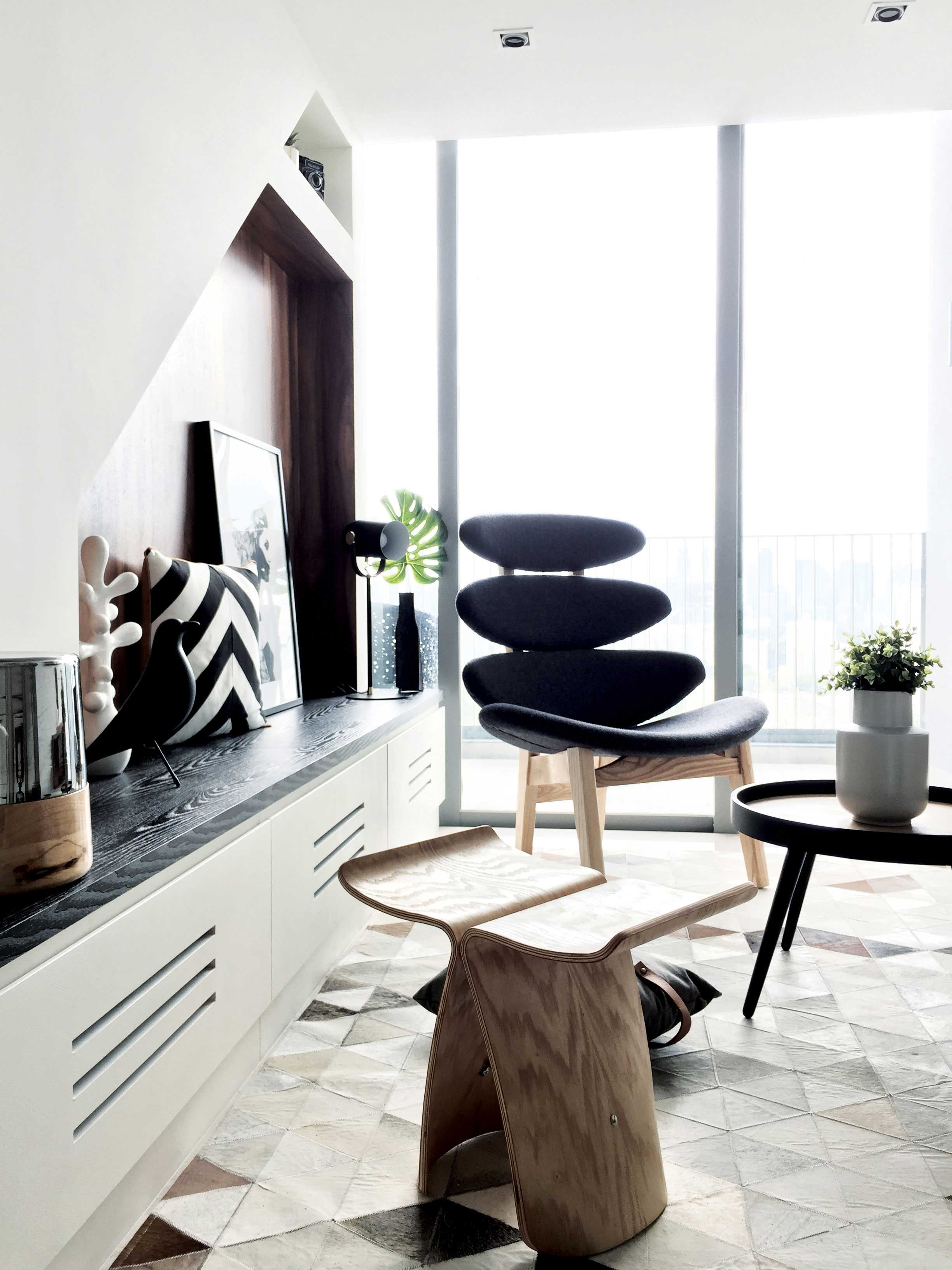 Compact yet chic living room dressed in monochrome hues.