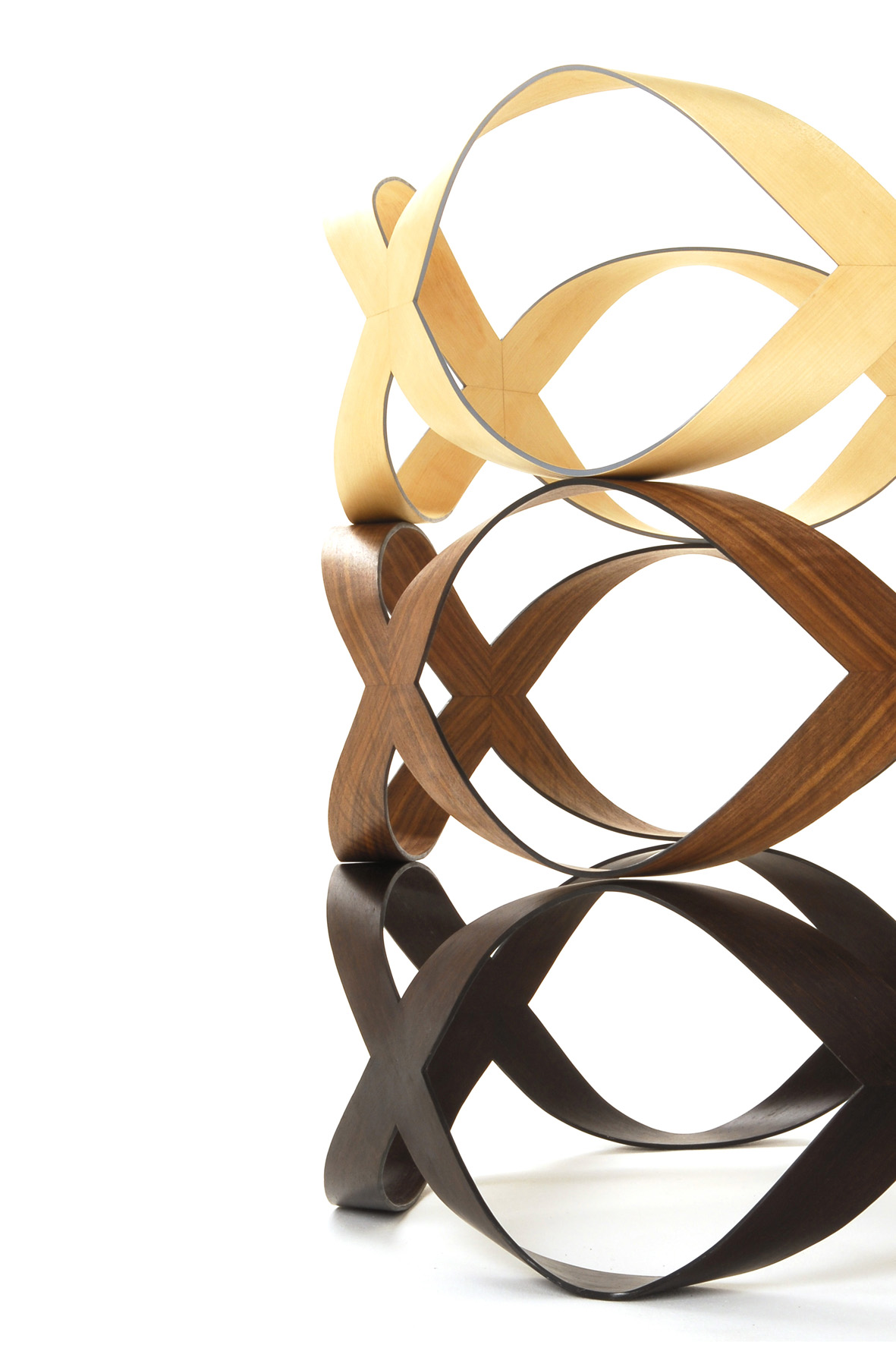 'Infinity + 1' coffee table - This multi award winning coffee table delivers intrigue and beauty through its elegant, flowing lines. Designed to be a piece of functional sculpture, 'Infinity + 1' is contemporary in style, yet very capable of sitting comfortably in any environment thanks to its relaxed and harmonious form.The aesthetic simplicity of 'Infinity + 1' masks both its complex construction and the deceptive strength of such a ribbon like structure.This table is available in American Black Walnut, Maple, Sweet Chestnut or Cherry as standard, other timbers, including coloured veneers, are possible but may incur a small surcharge.  Edge colours can be matched to specific colours or existing décor.Dimensions: Height 30cm, diameter 100cm Price: £2900