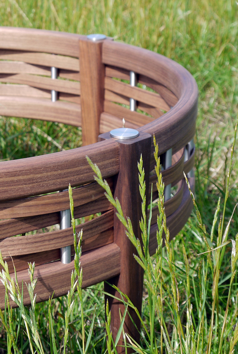 Watul coffee table - Wattle, or watul in old English, hurdles date back over 6000 years and are fencing panels woven from coppiced round wood timber.  I learned to construct them in the traditional way from my father and have now taken them as inspiration for my 'Watul' range of furniture.This coffee table combines rich, chocolatey American black walnut with stainless steel and glass to give a contemporary twist to an ancient aesthetic.  The decorative woven element can be incorporated into various designs from different shapes and sizes of coffee table to sideboards, beds, chairs and kitchen cabinet doors. Dimensions: Height 40cm, diameter 87.5cmPrice: £1900