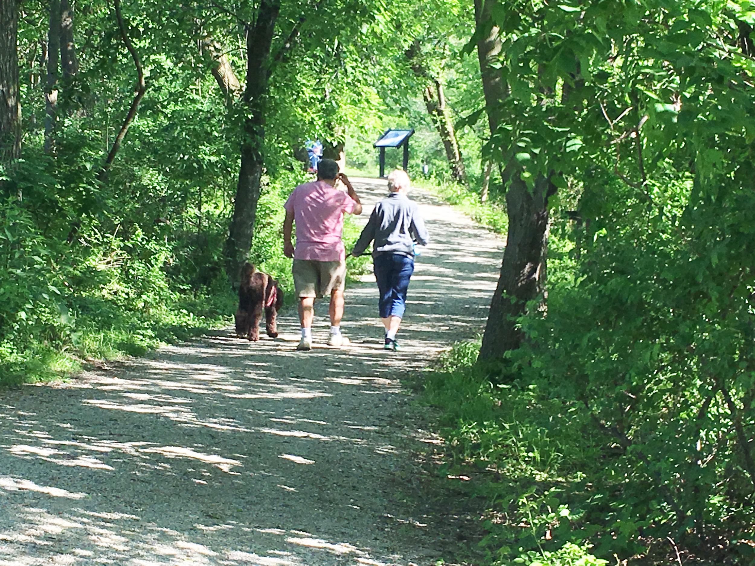 An older couple walking on the Capital Greenbelt in Wildwood Park, Harrisburg