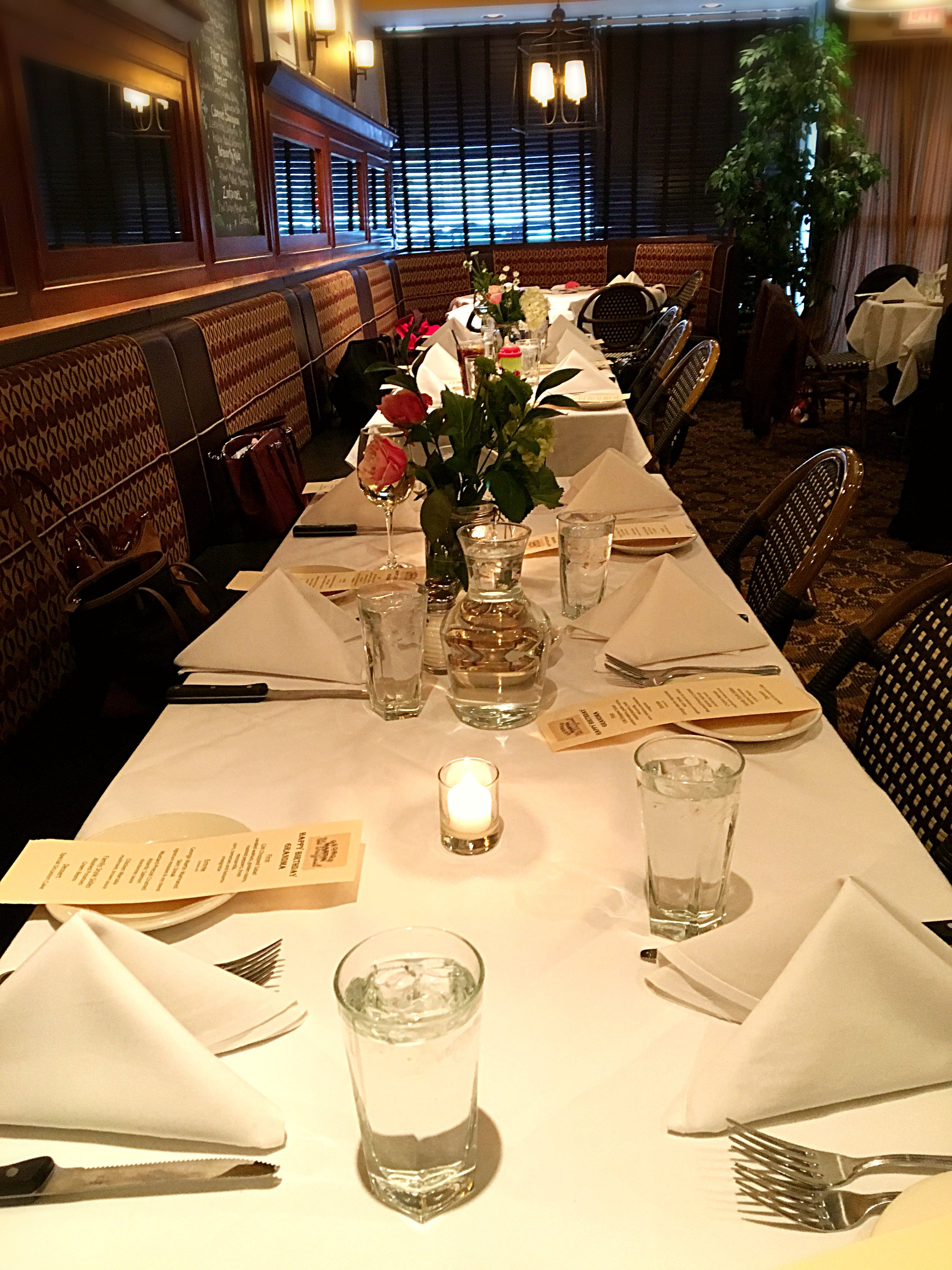 A photo of a table setting in our Side Car room.