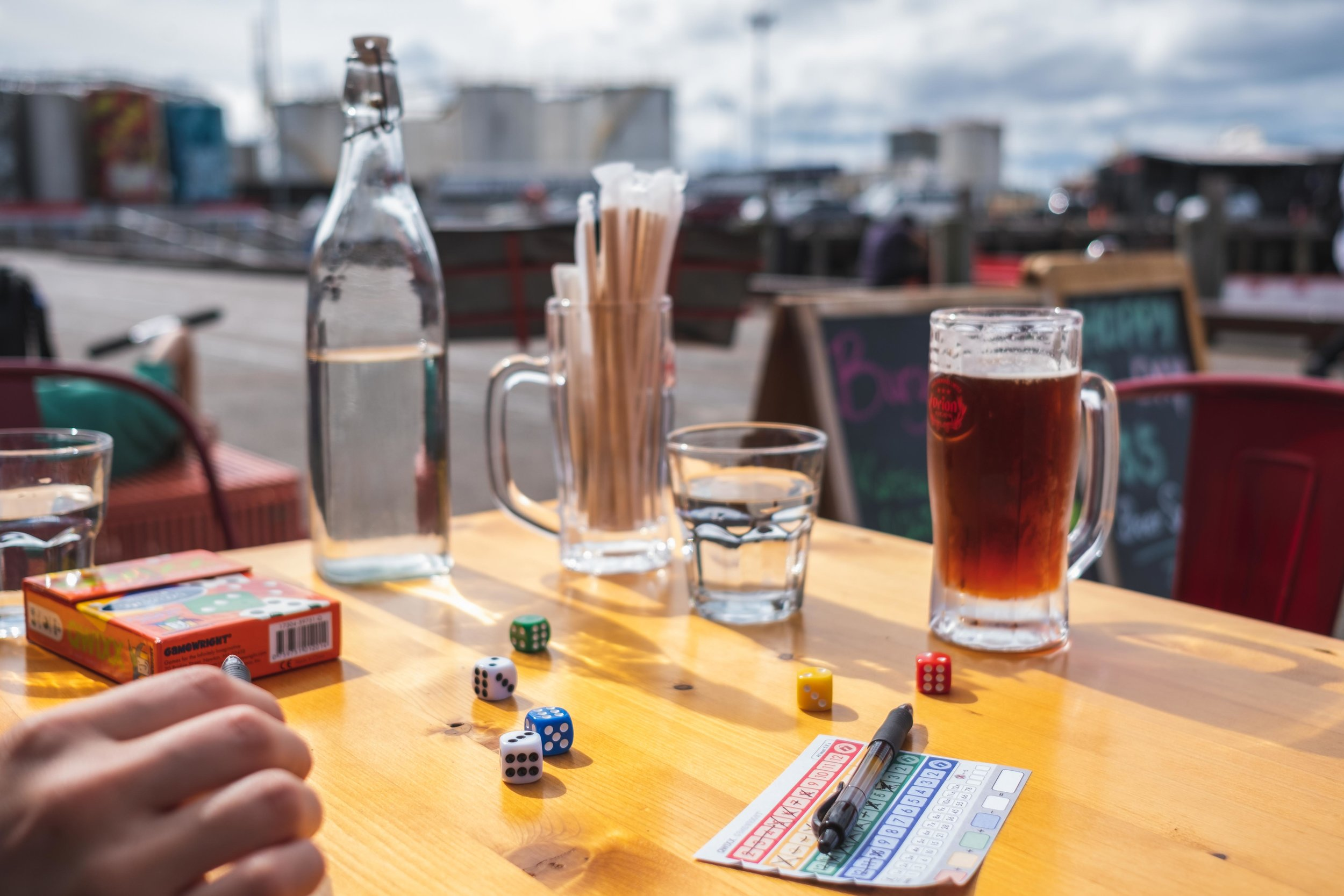Playing some Quixx at a boardwalk cafe in Auckland