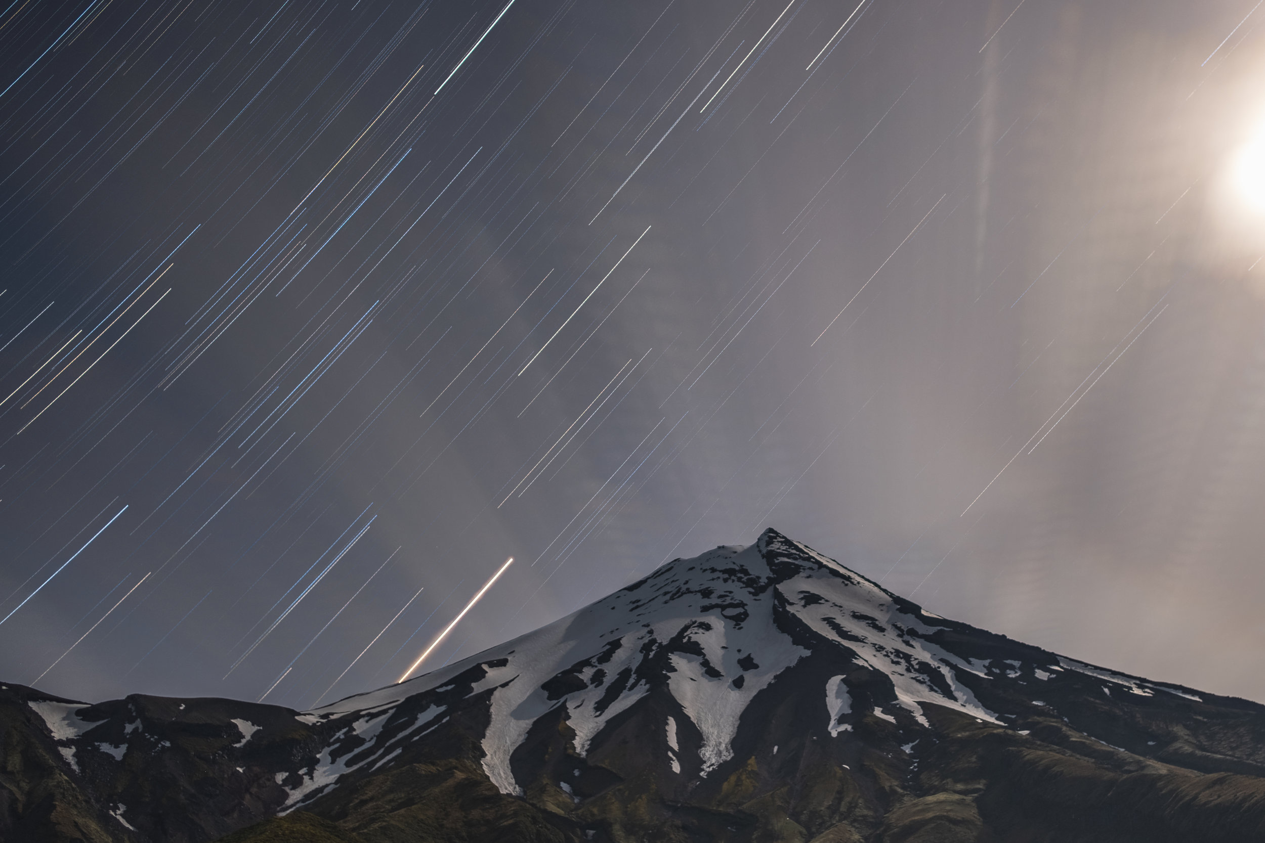 a night time peak with star trails