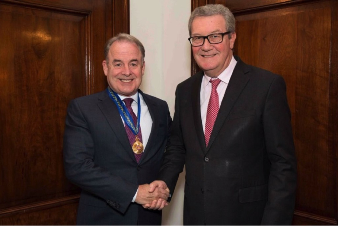 Mr. Hogan receives his investiture from the High Commissioner of Australia, The Honourable Alexander Downer, AC